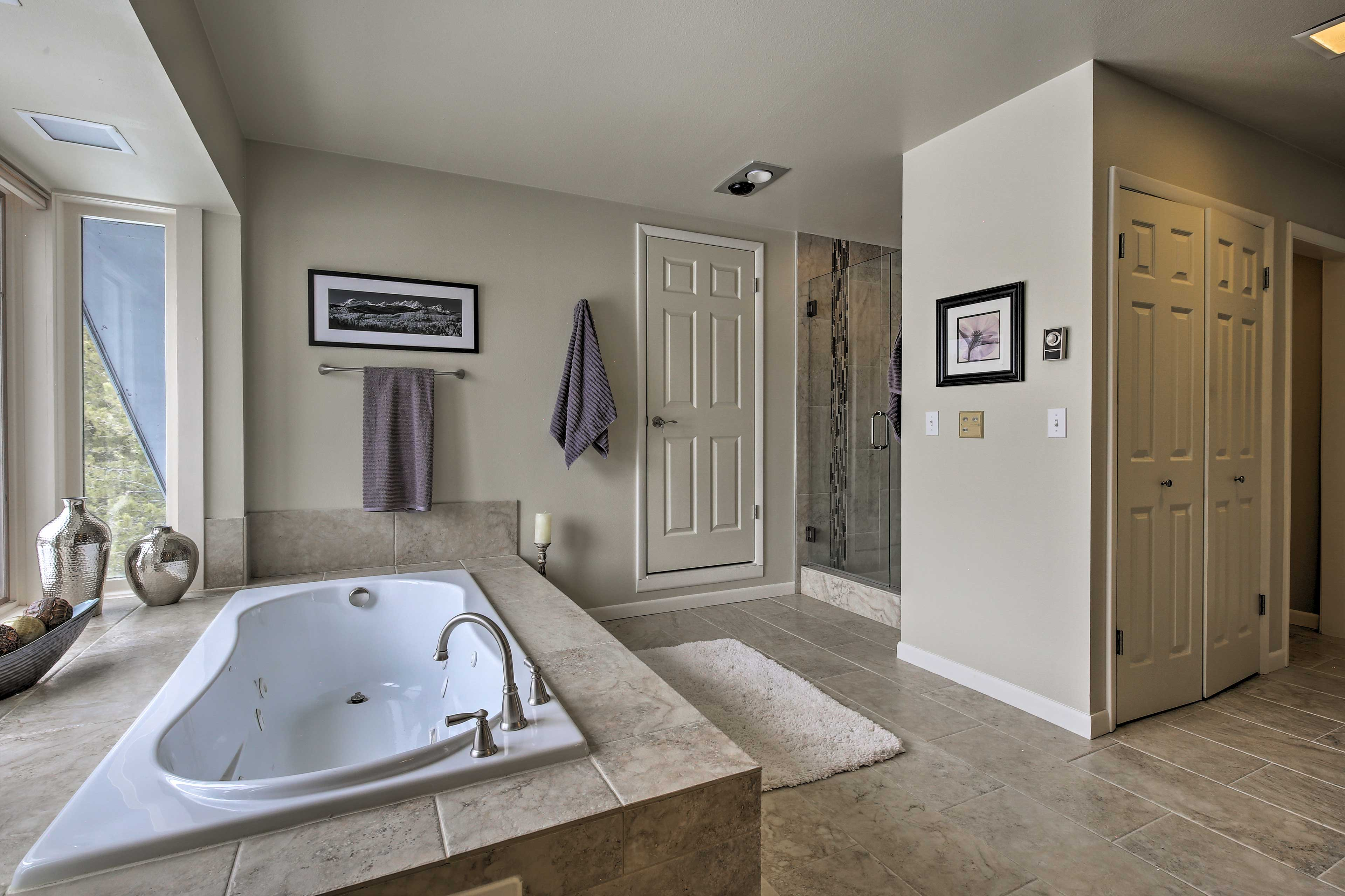 Enjoy a soothing soak in the jetted tub.