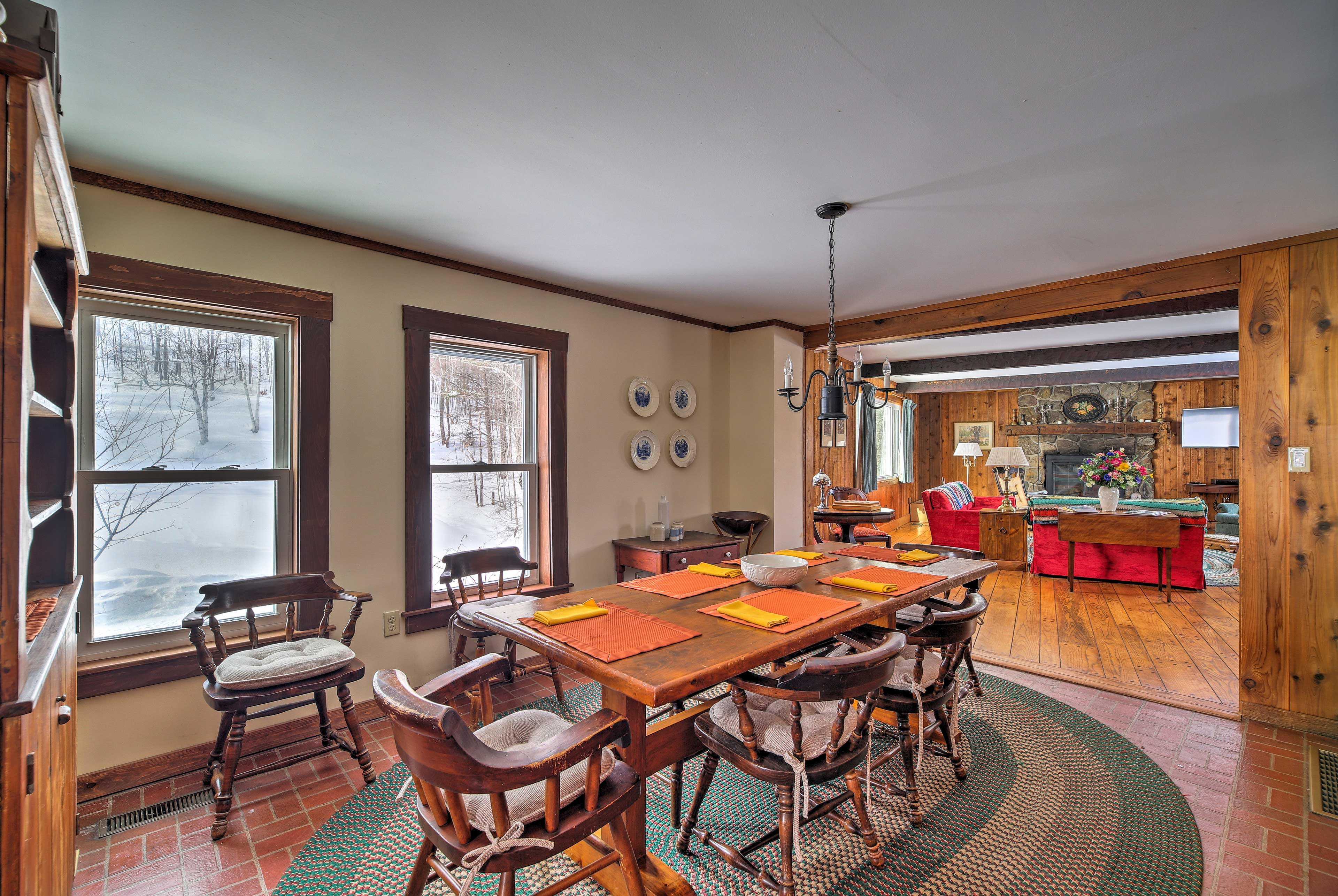 As you dine at this table for 6, admire the natural views out the large windows.