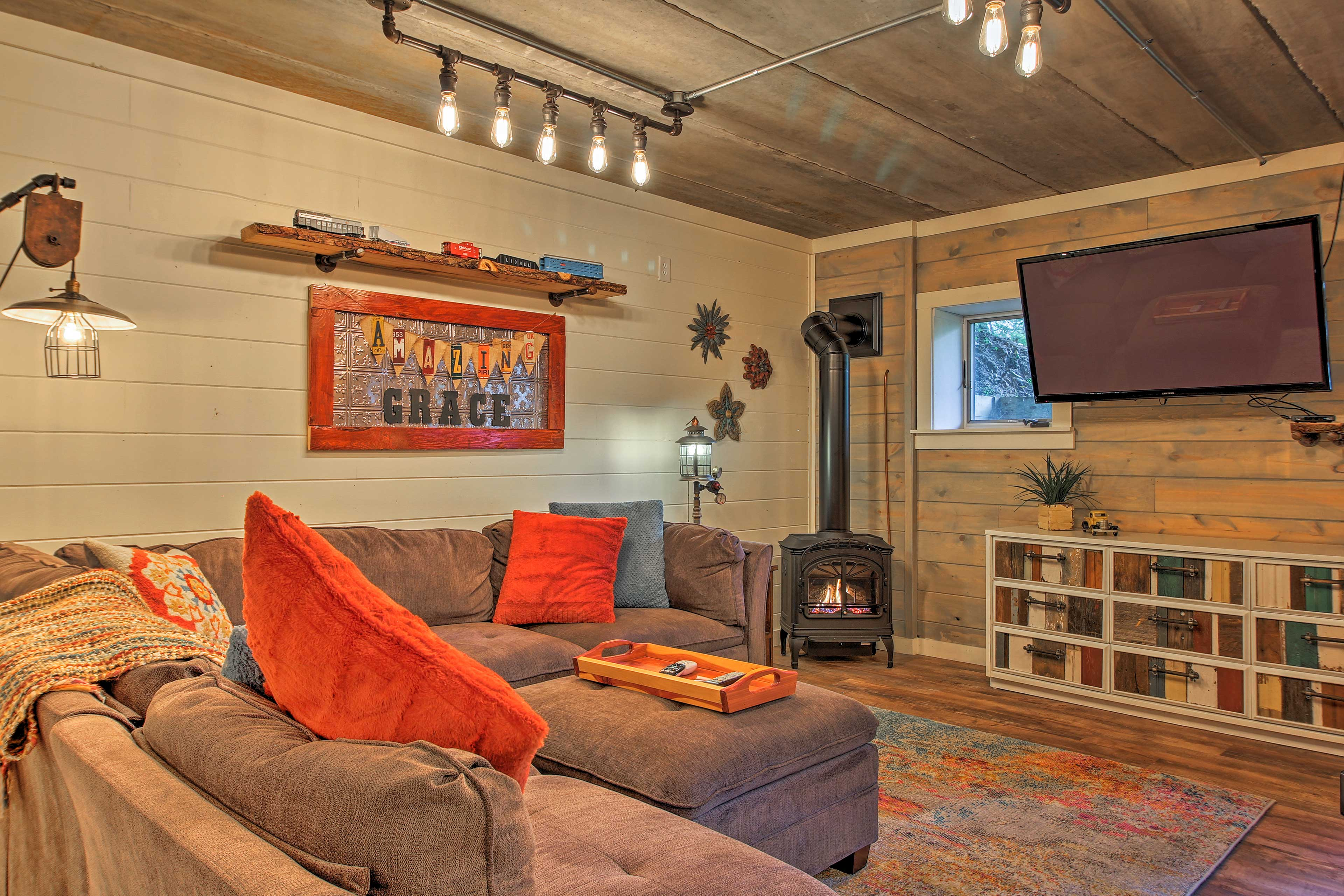 The 3,500-square-foot lake home offers guests 2 open living spaces.