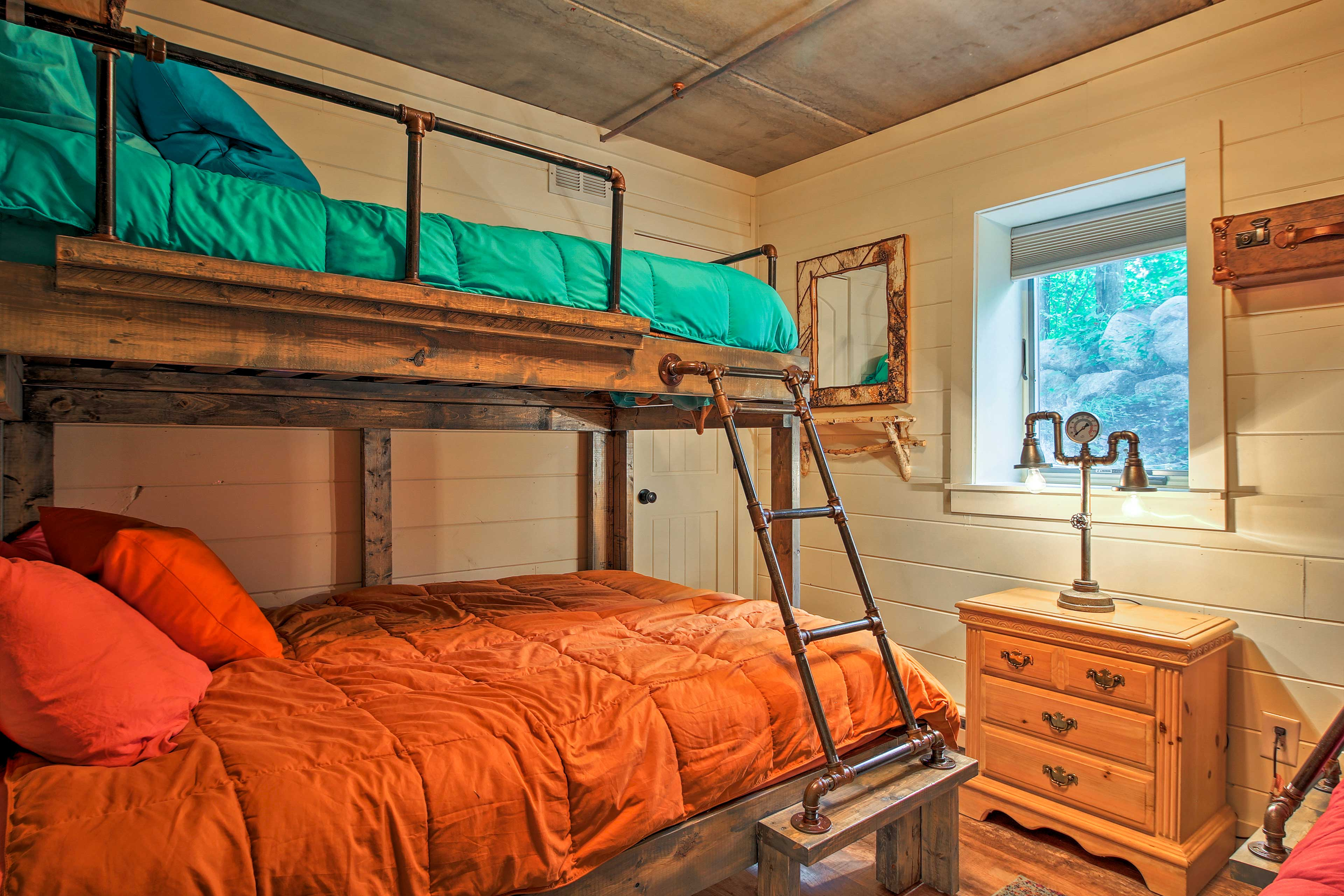 Both of the bunk rooms are next to this 2nd living room downstairs.