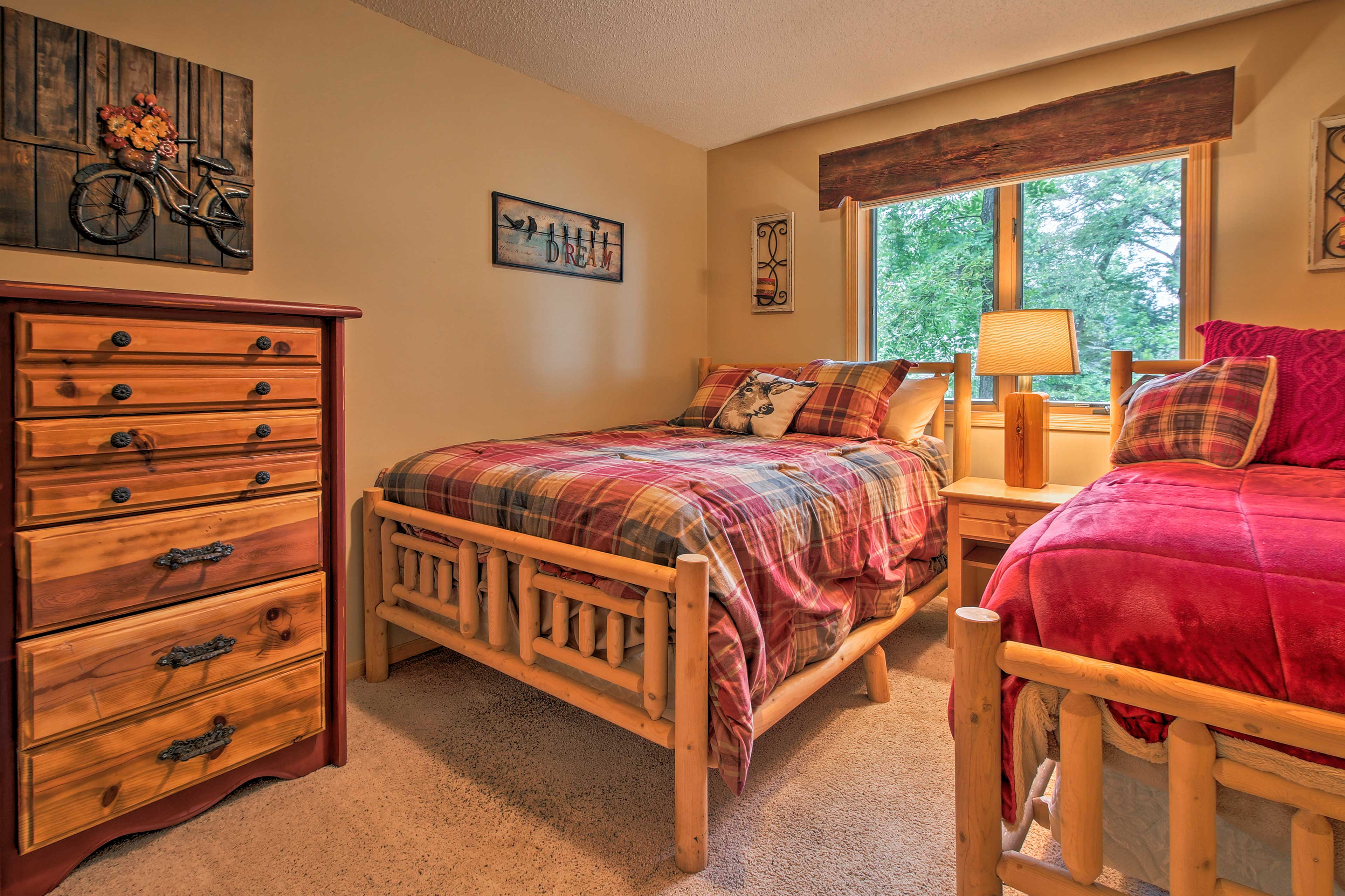 This bedroom includes a twin and full bed.