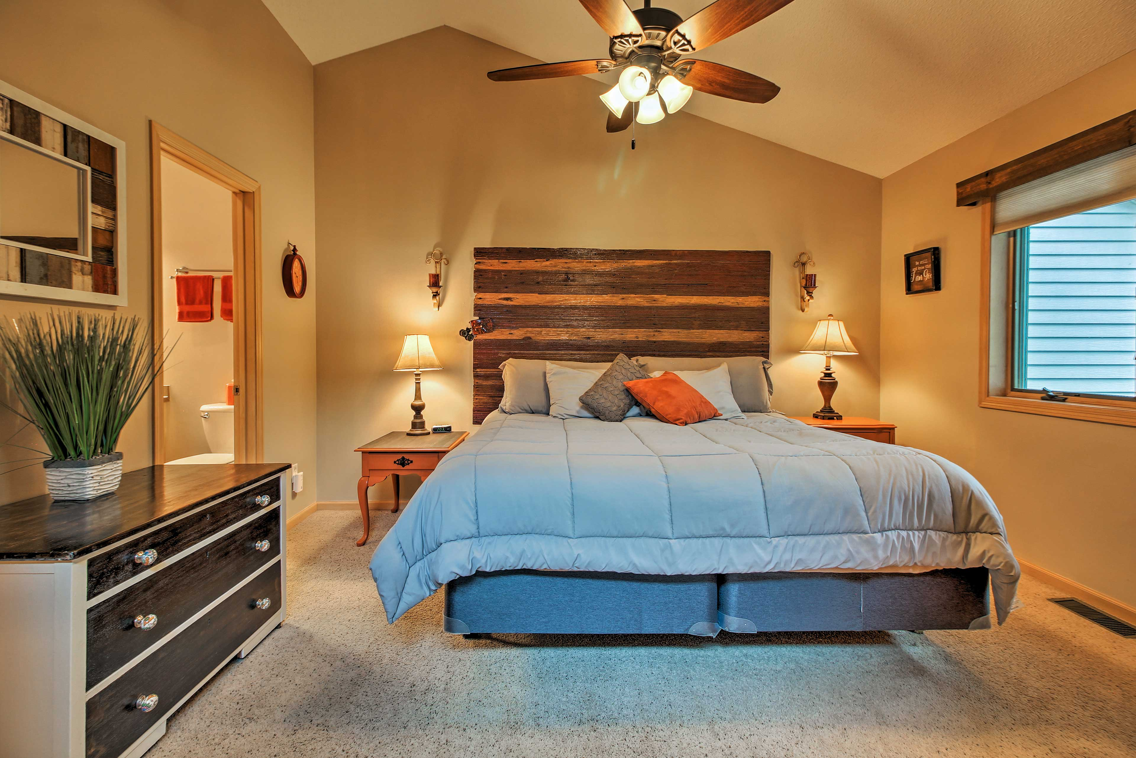 The master bedroom boasts a comfortable king mattress.