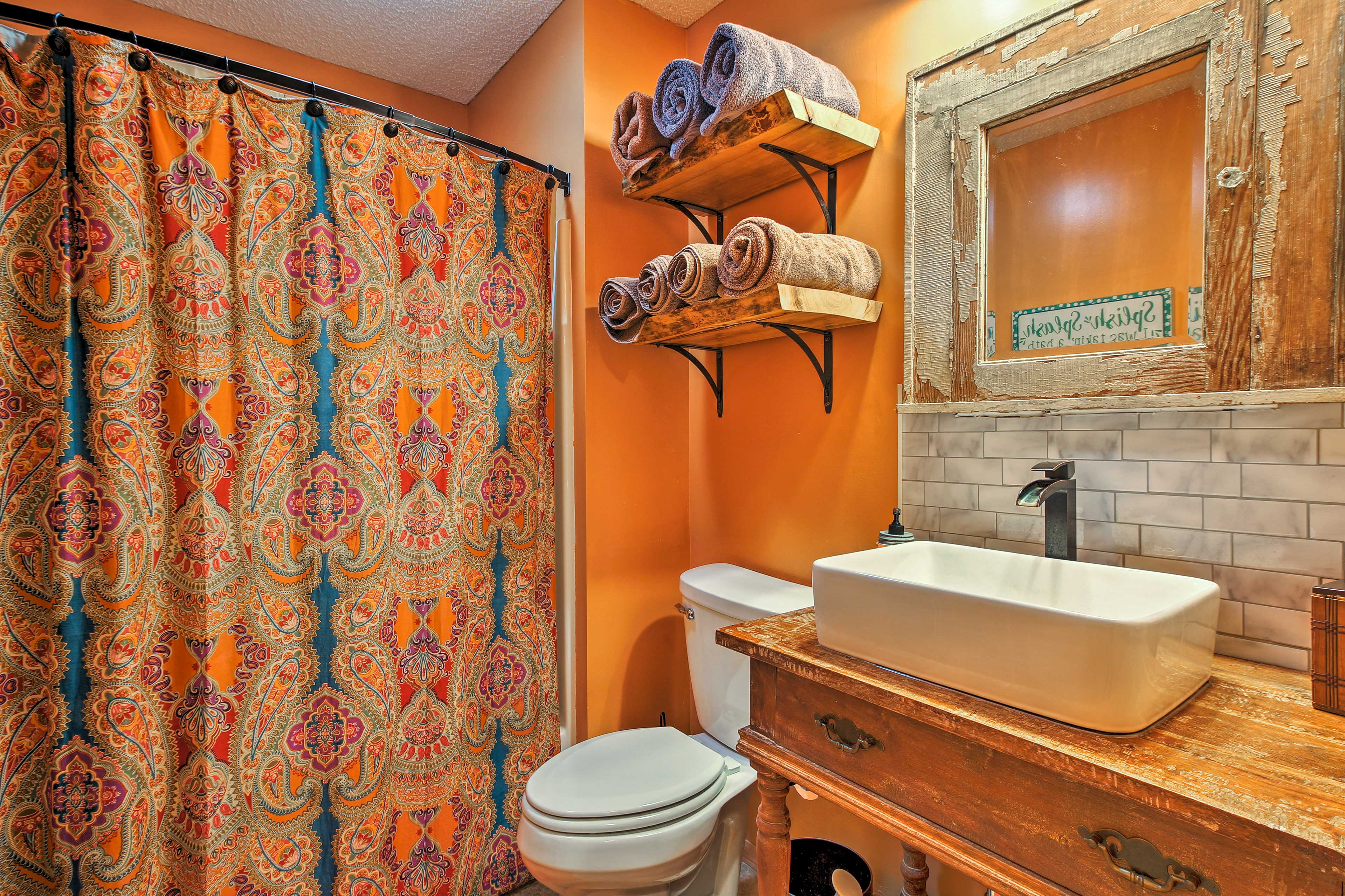 Rinse off with a shower in this stylish bathroom.