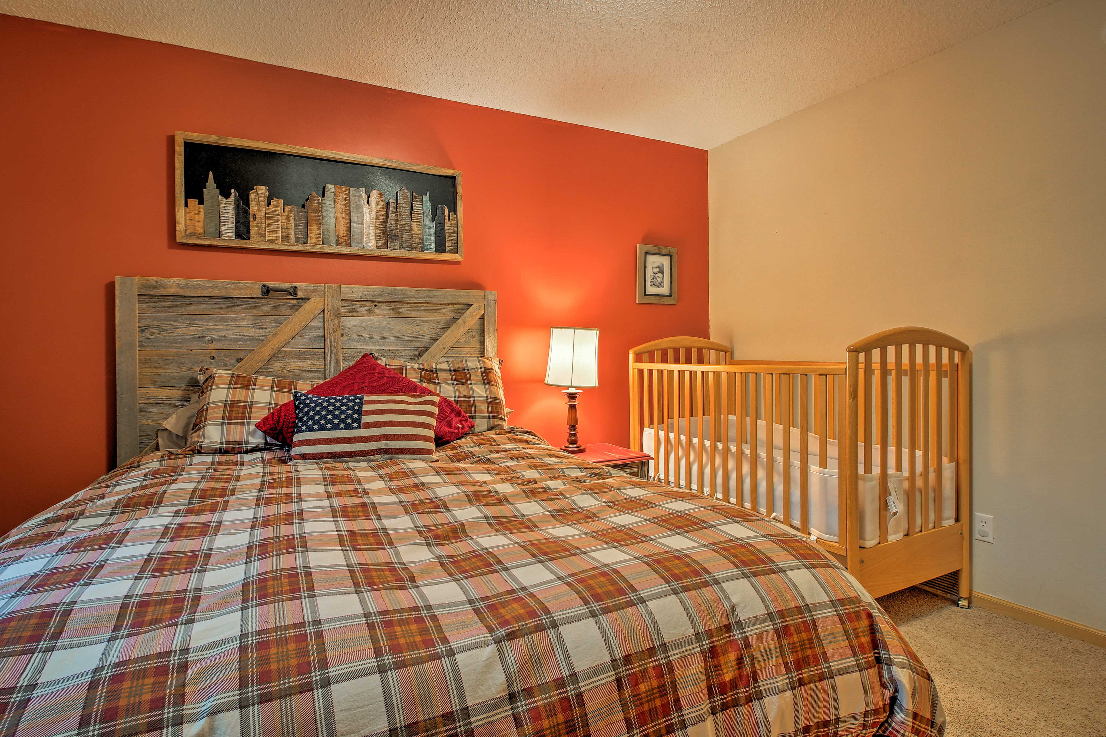 This room also comes with a baby crib!