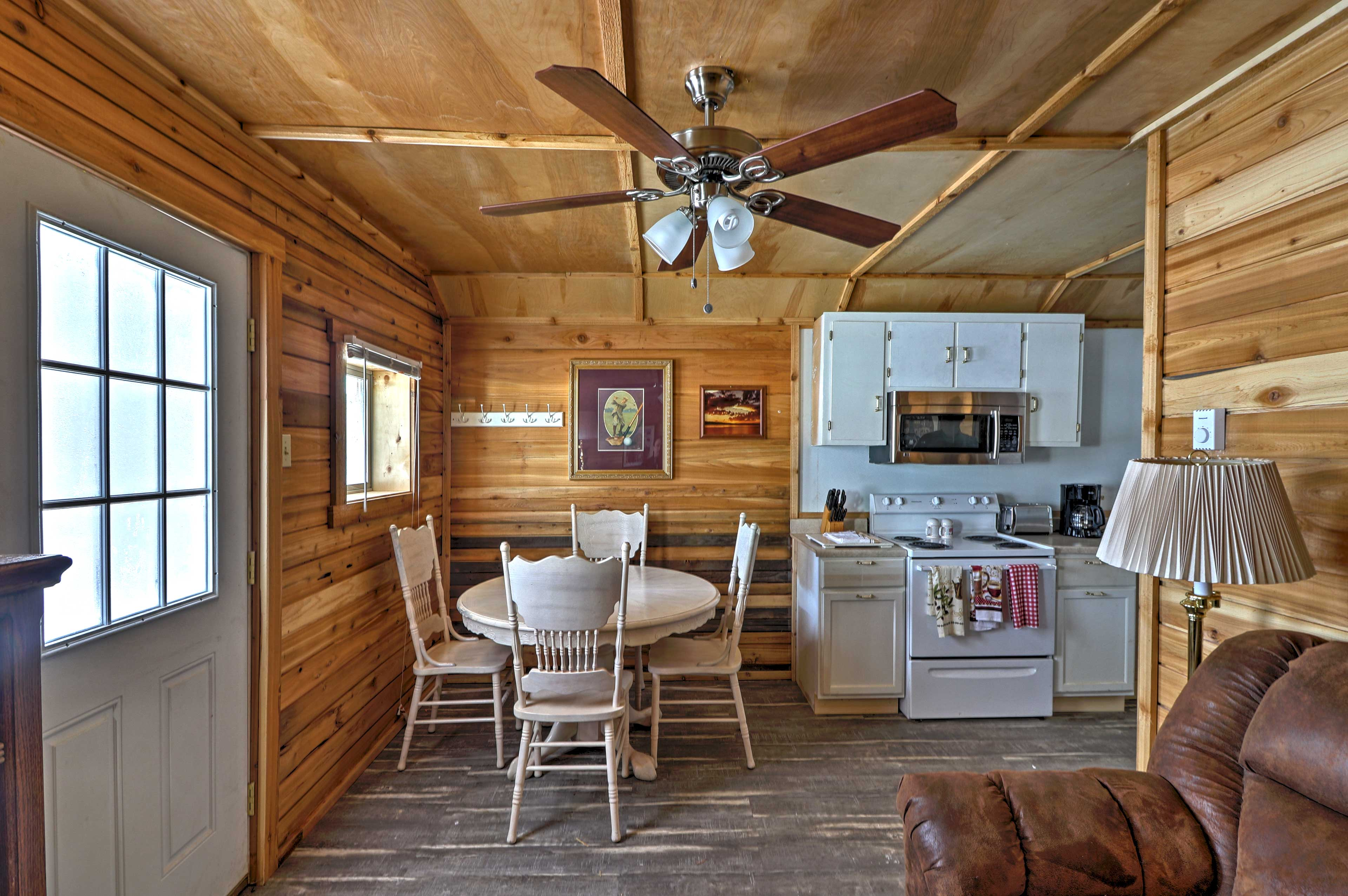 The interior features hardwood floors and pastoral decor.