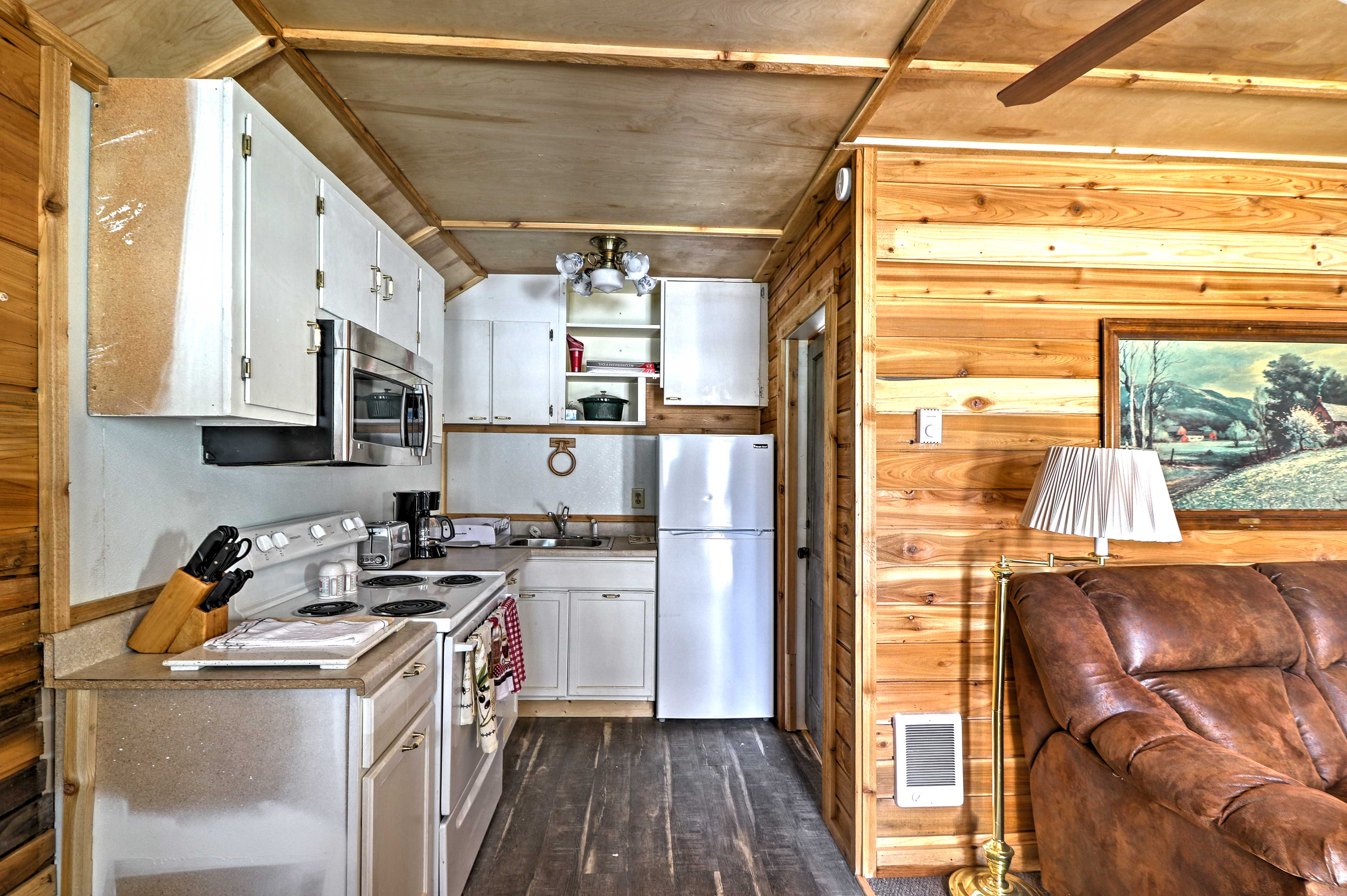 Easily move from kitchen to table or living room in this cozy unit.