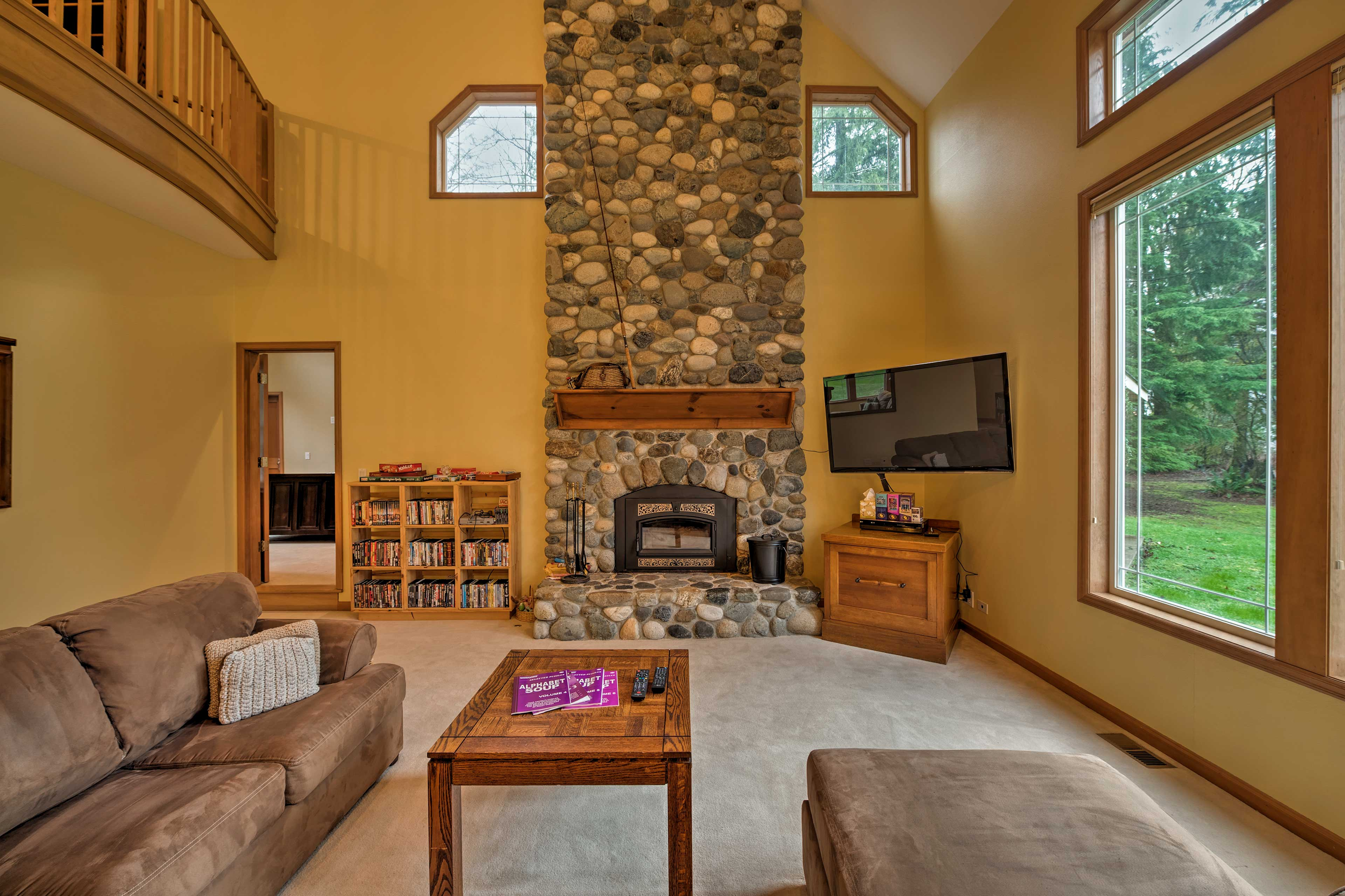 Lounge in the open living room as you warm your toes by the fire.