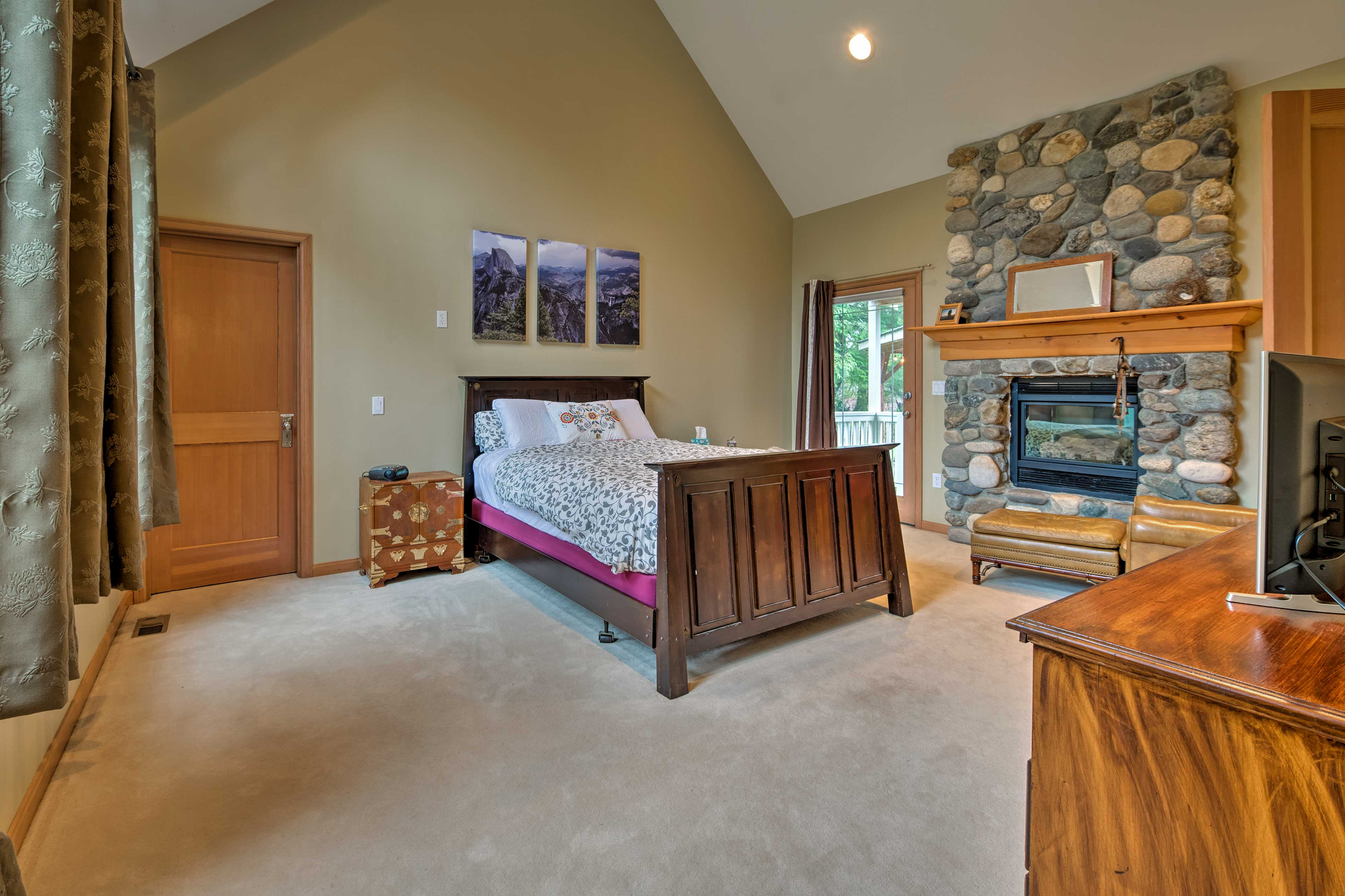 The master bedroom features a gas fireplace and flat-screen Smart TV.