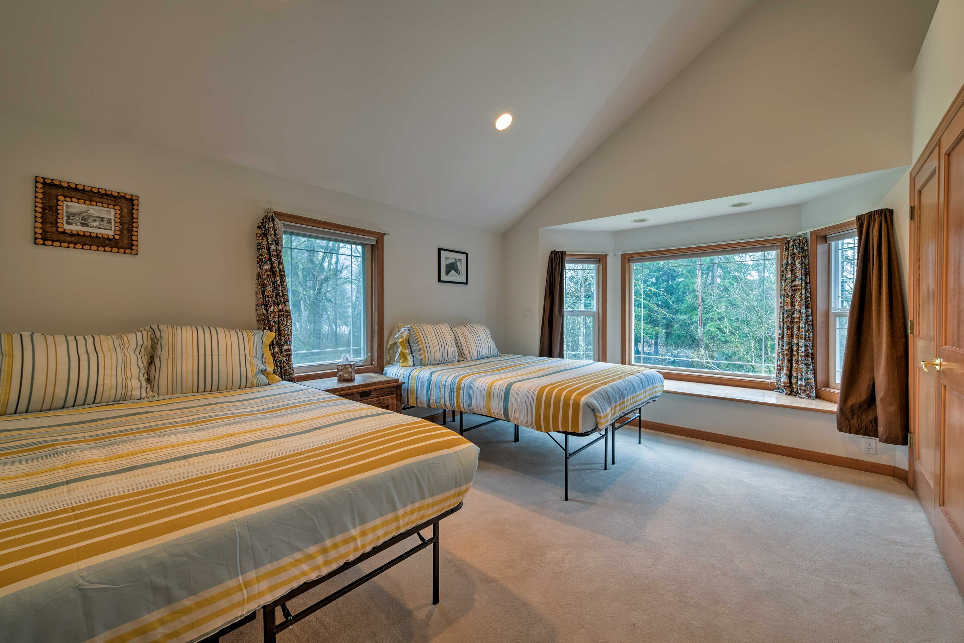 This second bedroom boasts 2 queen beds.