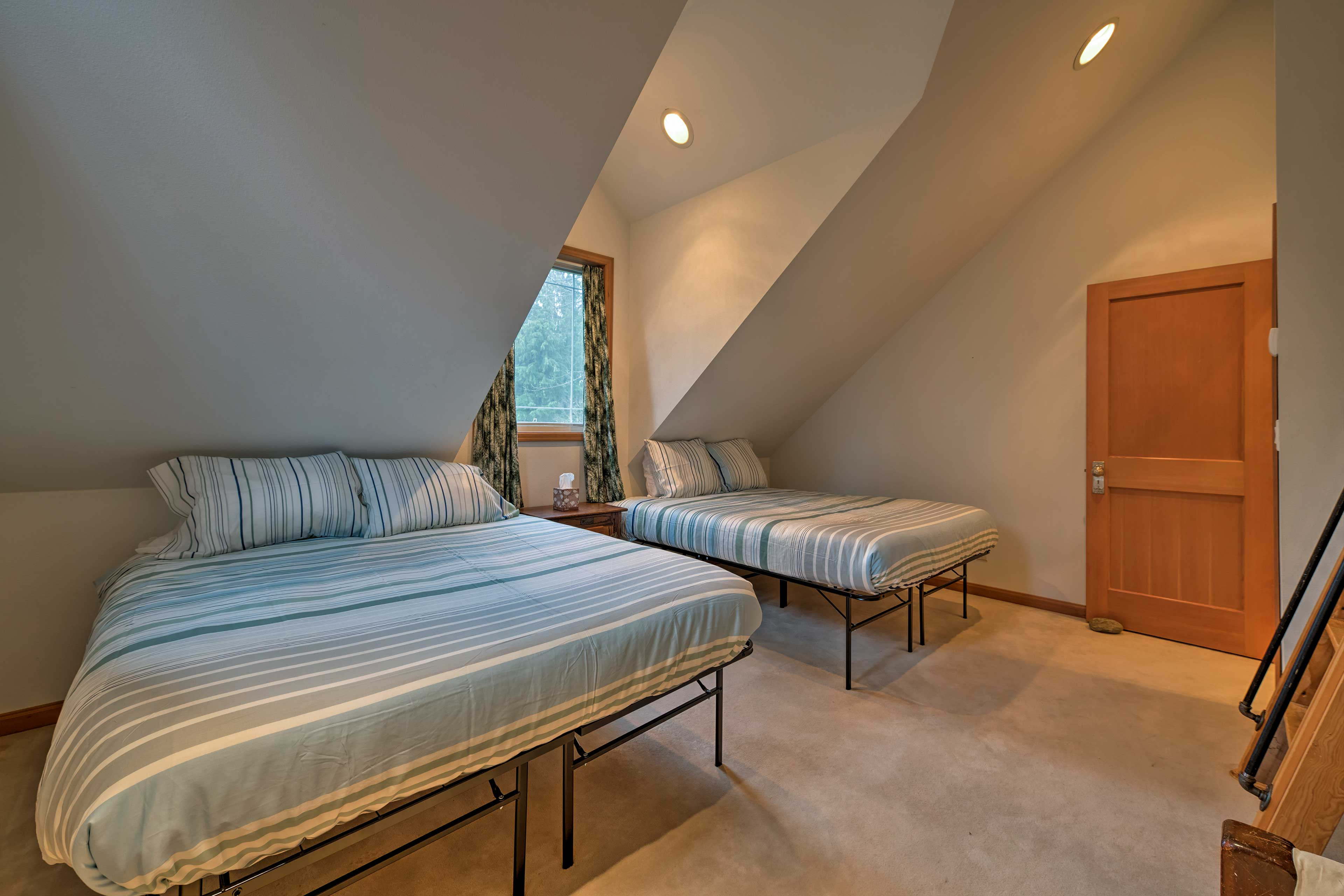 This last bedroom boasts 2 twin beds.