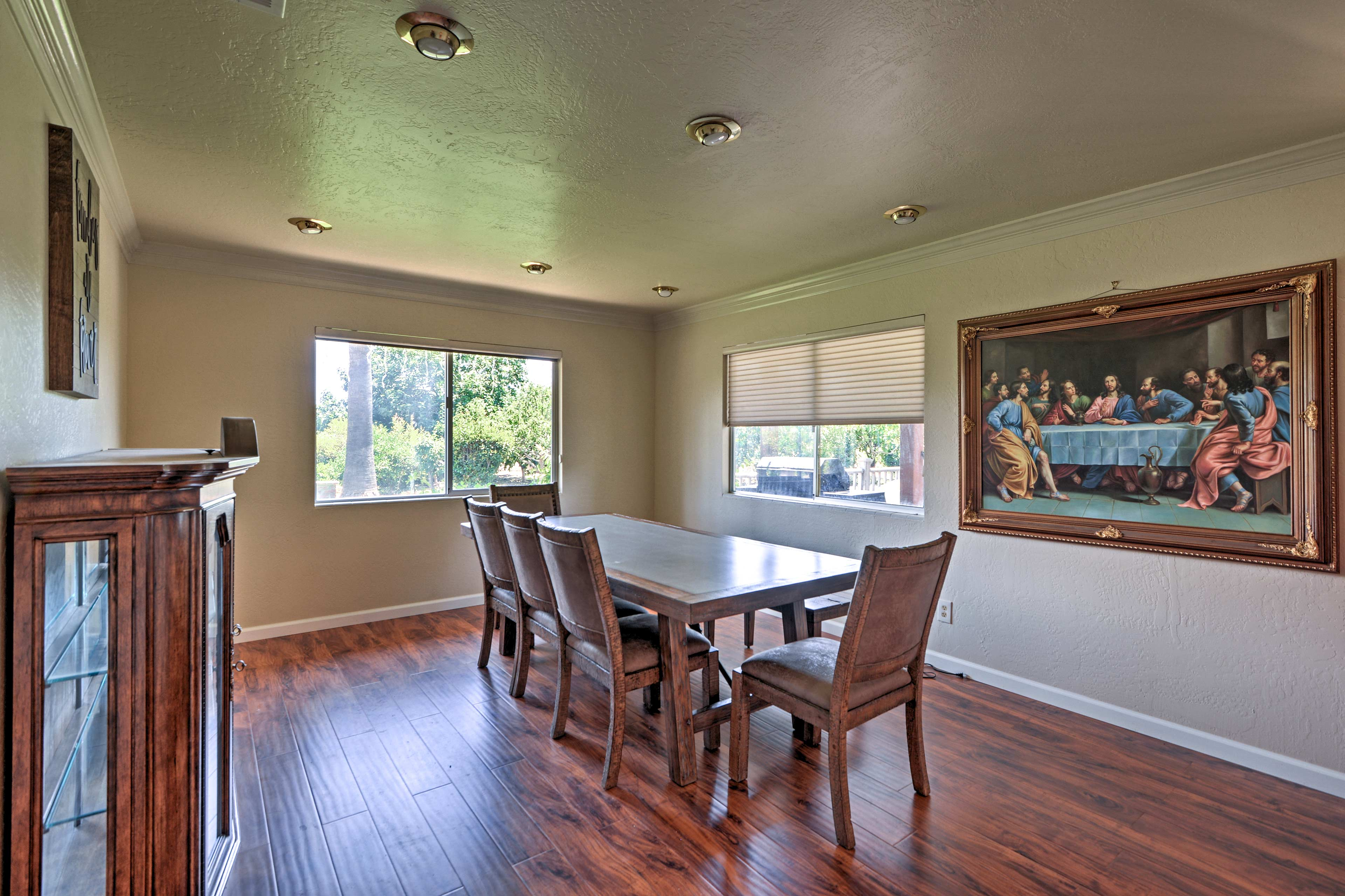 Share a family dinner around the 8-person dining room table.