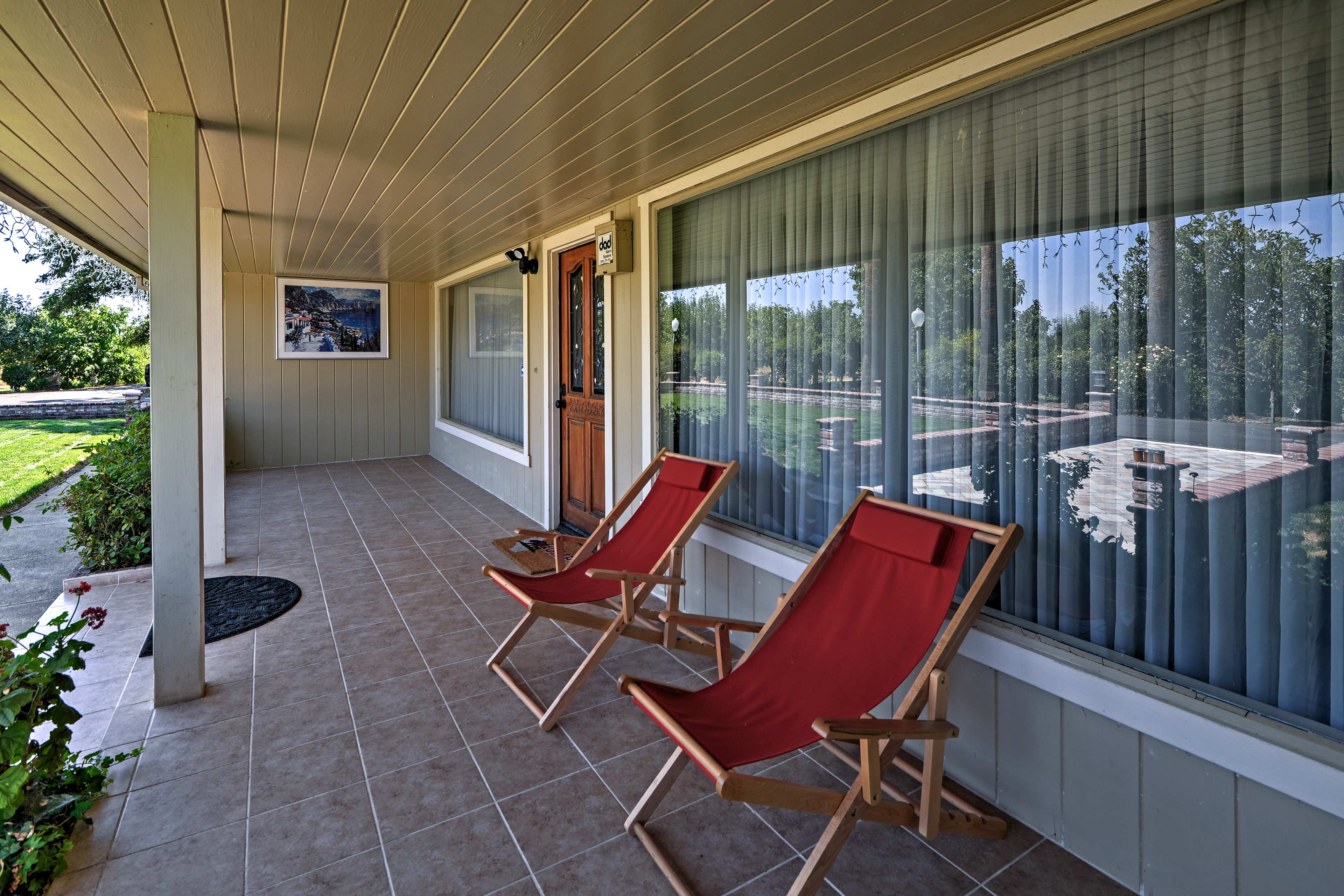 Sip your morning coffee on the front porch looking out at the palm trees.