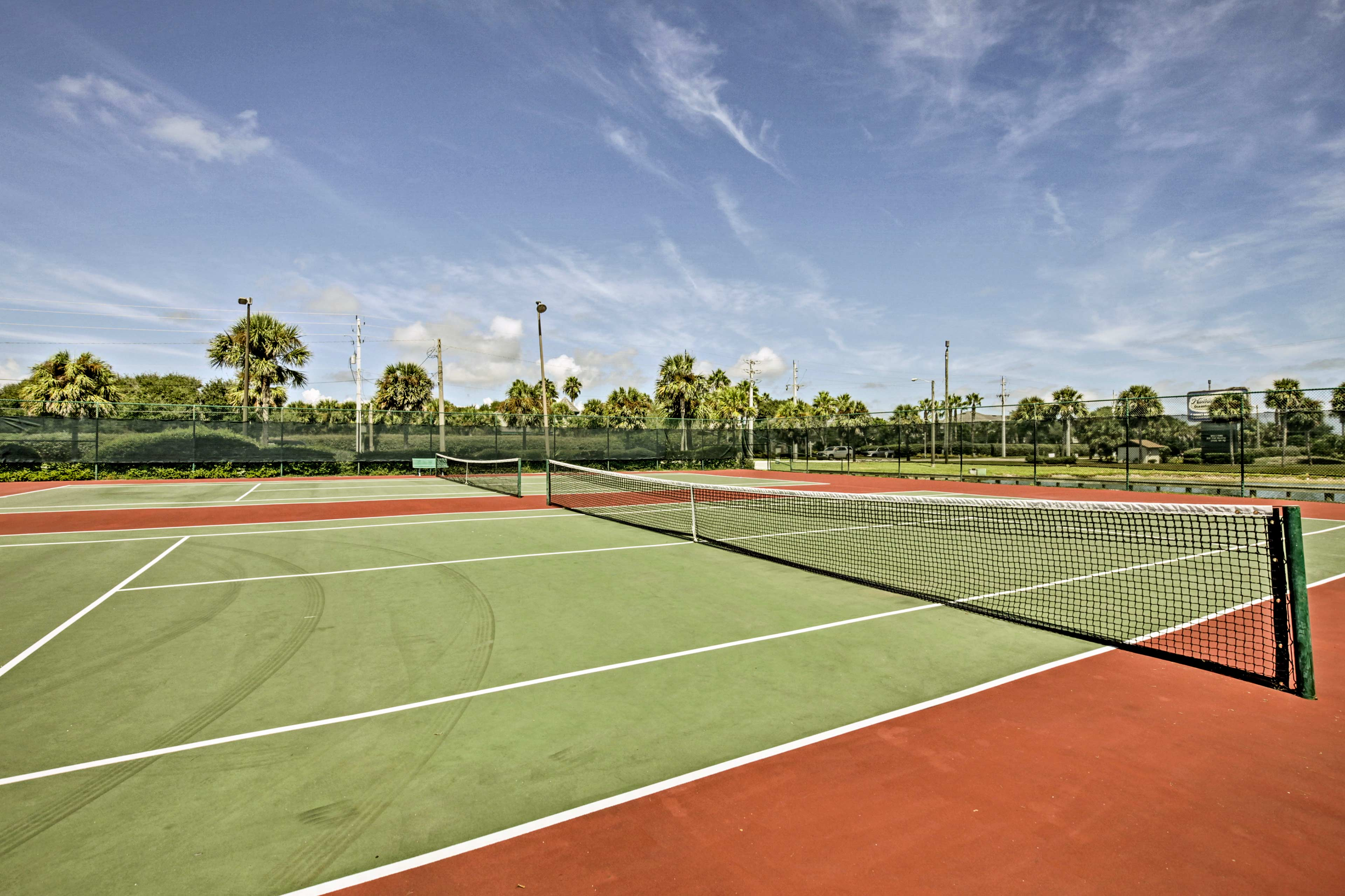 Enjoy free tennis lessons on the community courts.