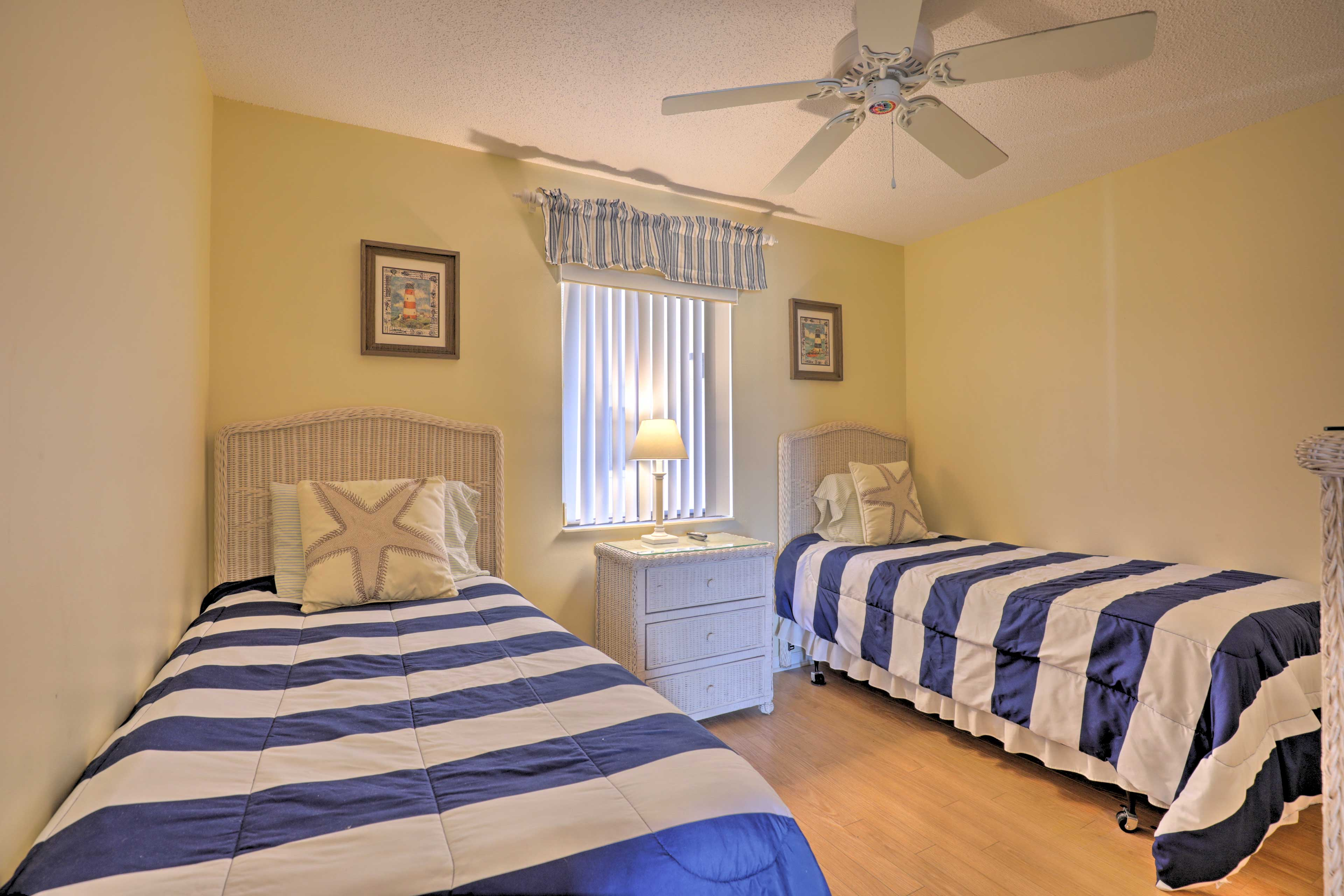 Tuck the kids into the 2 twin beds in the second bedroom.