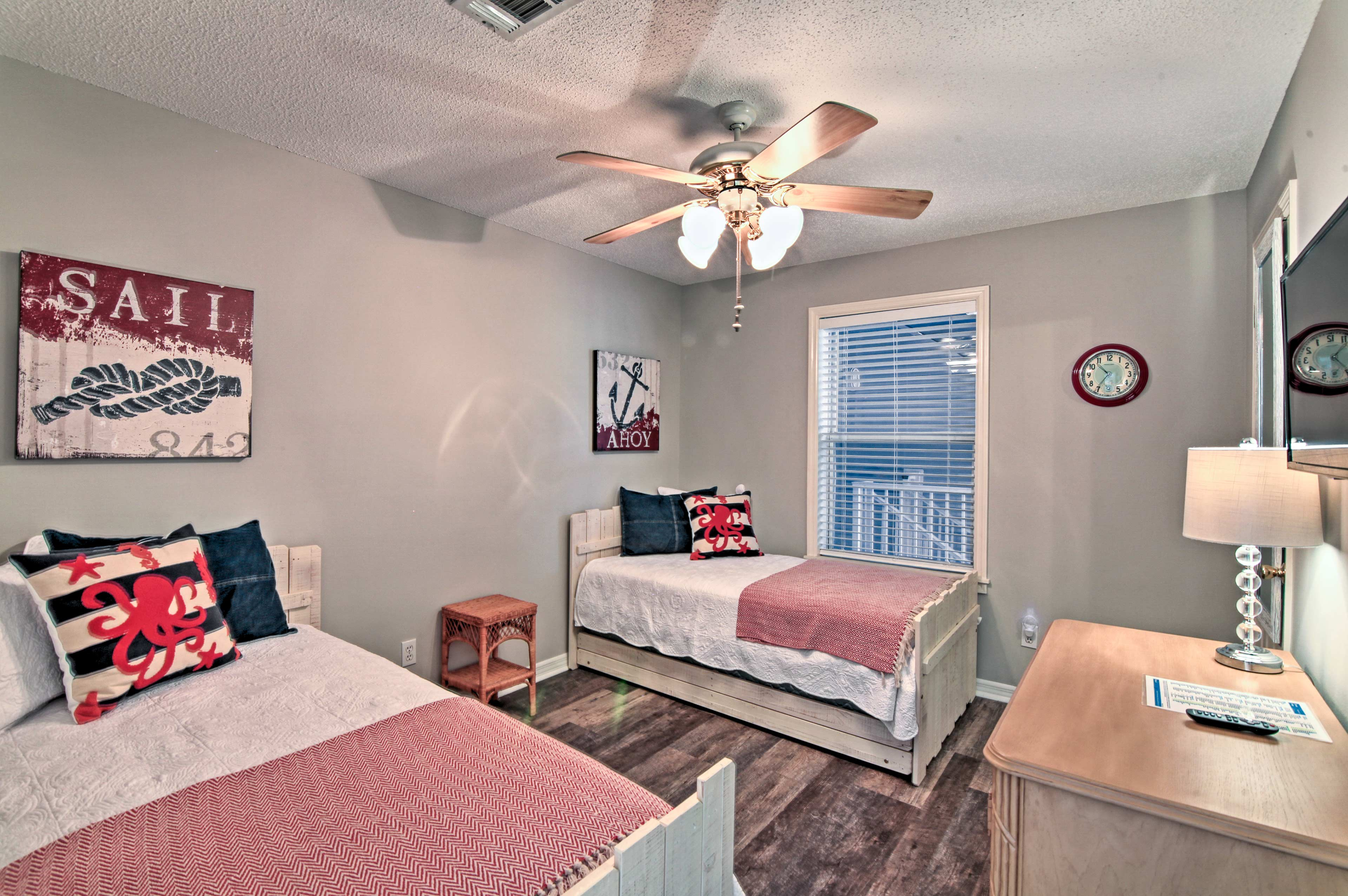 Kids will love sharing this room that hosts 2 twin beds and a trundle.