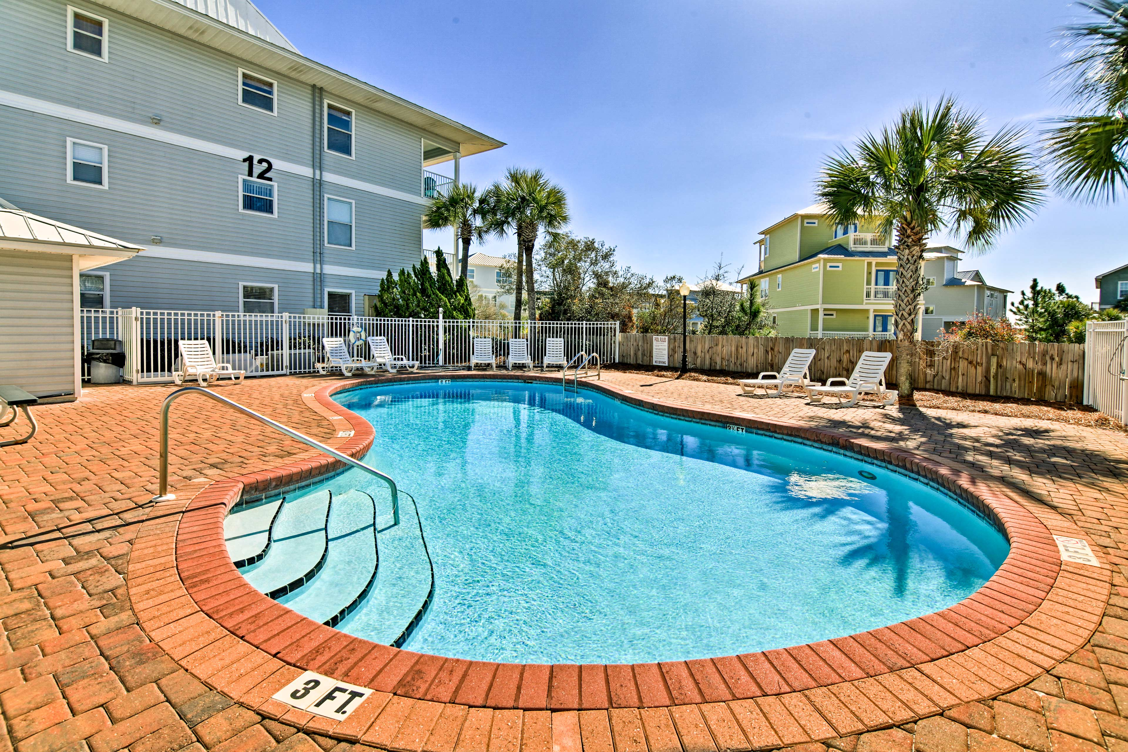 Swim laps in one of the 2 community pools.