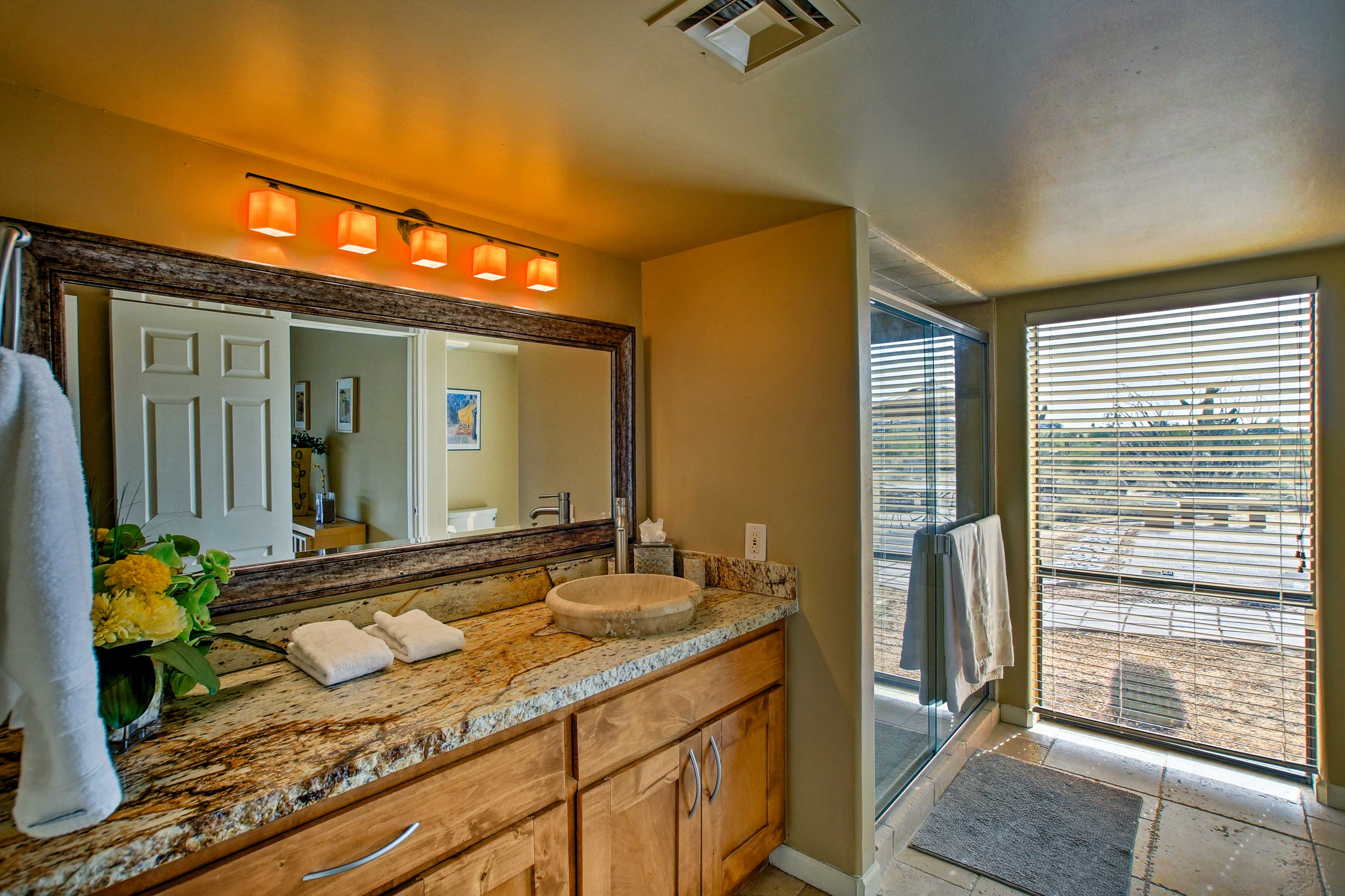 Prepare for a night out in the spacious bathroom.