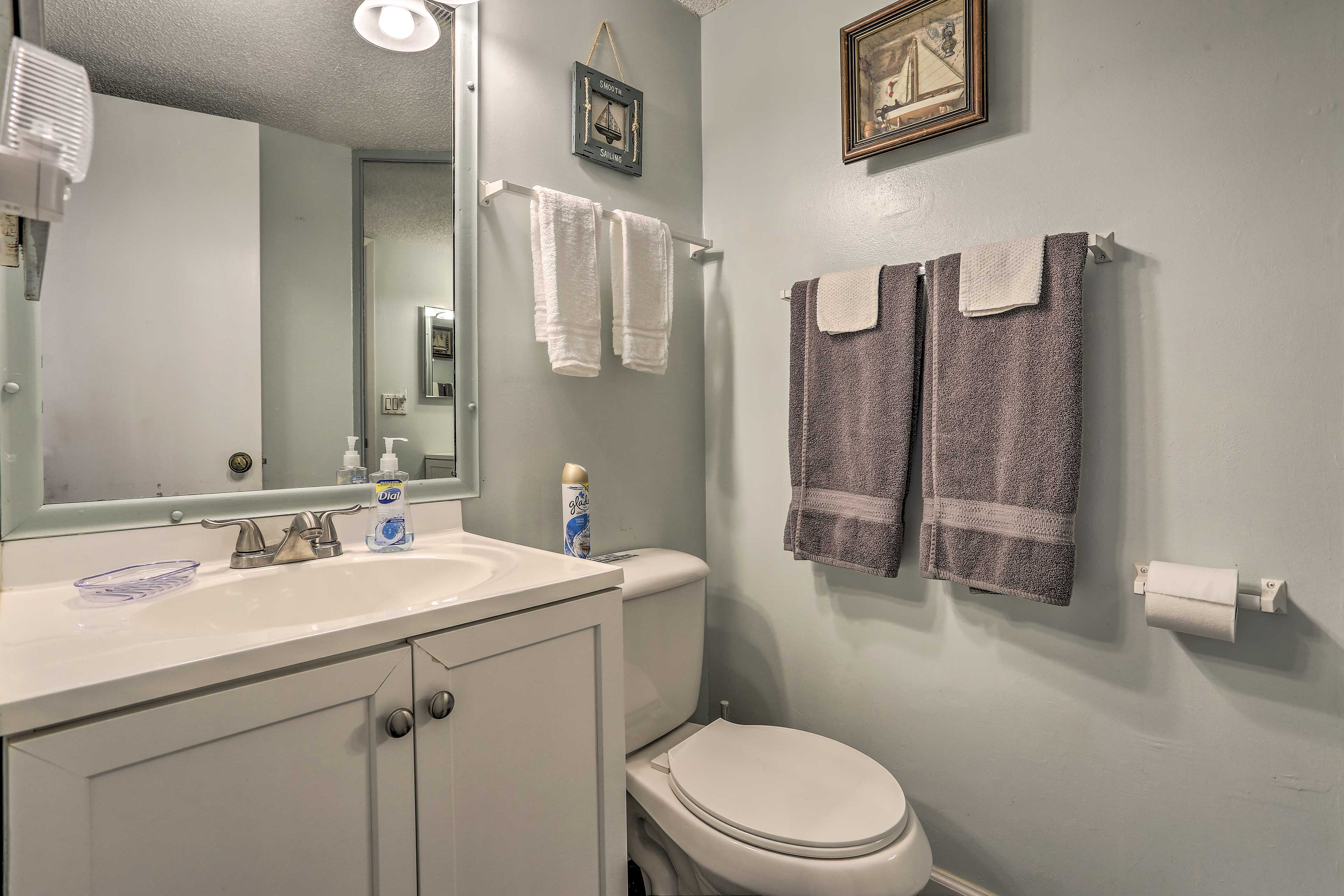 The second bathroom features a walk-in shower.