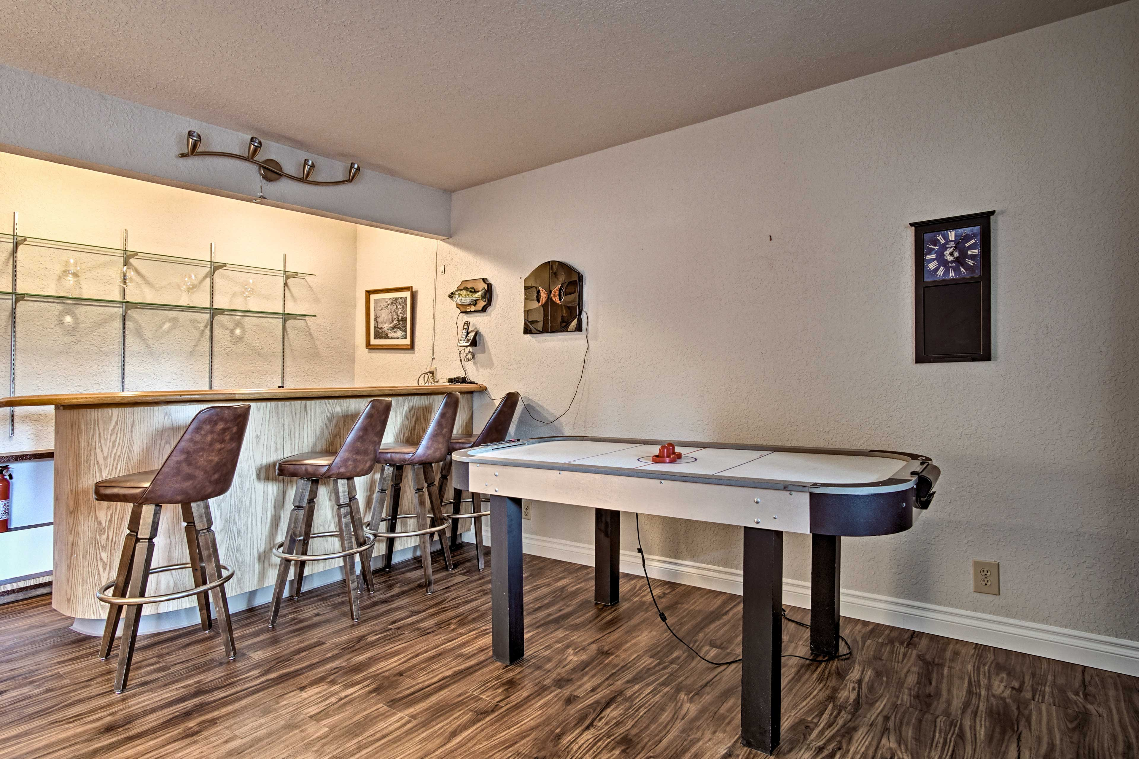 Mix a nightcap beverage at the wet bar and challenge your friends to a game!