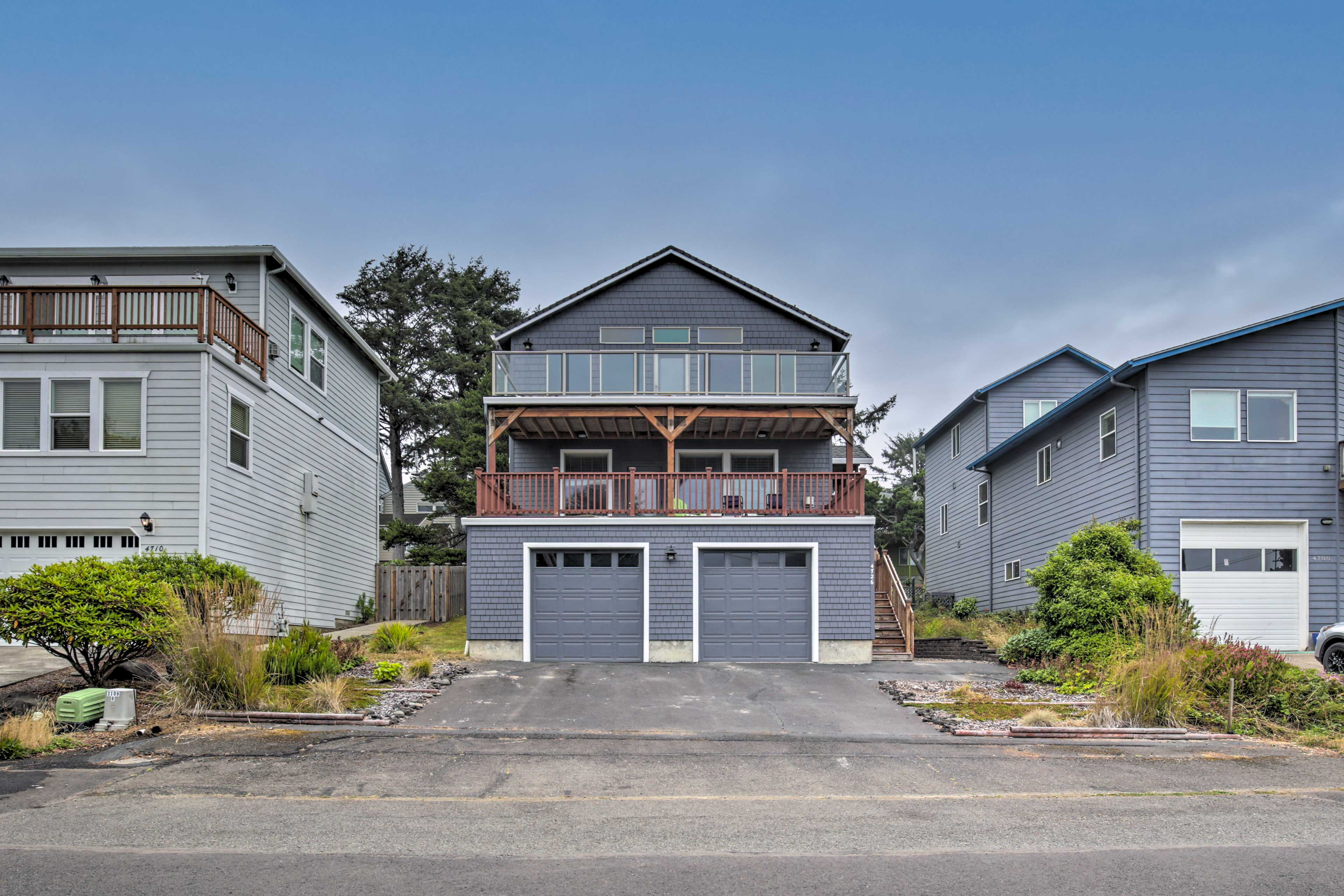 Ample parking is provided in the garage and driveway.