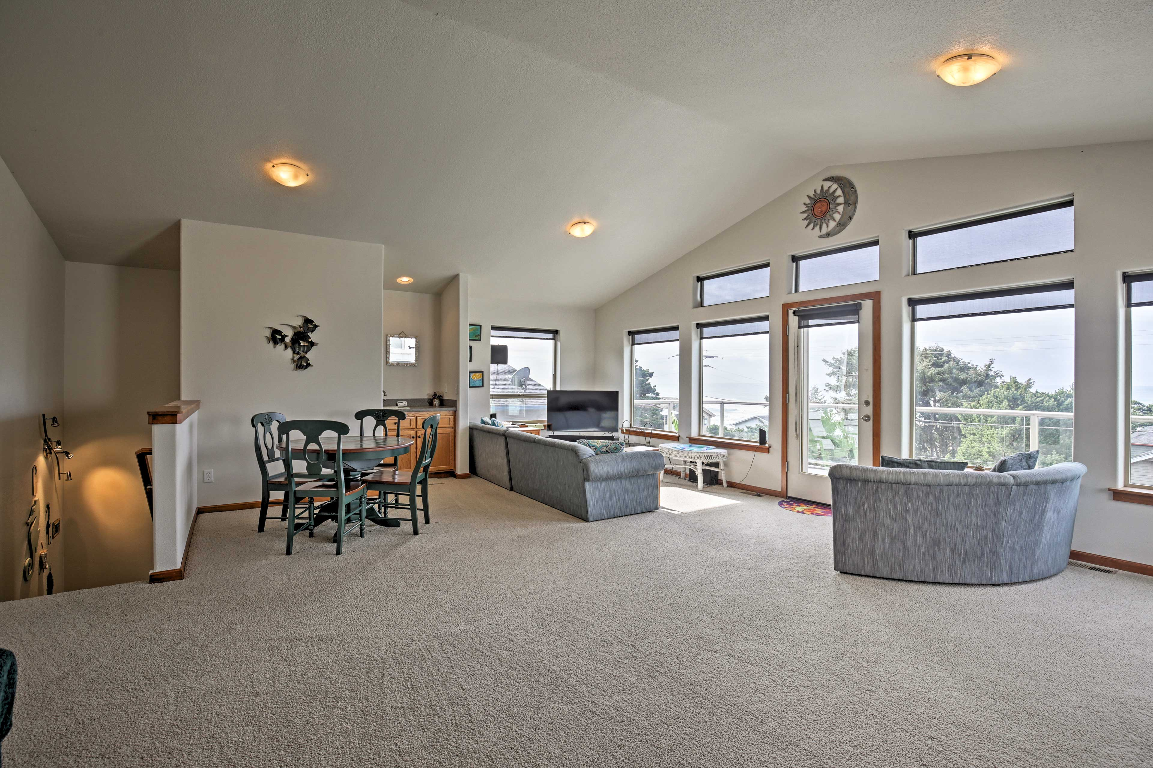 The split-level floor plan includes a spacious living area upstairs.