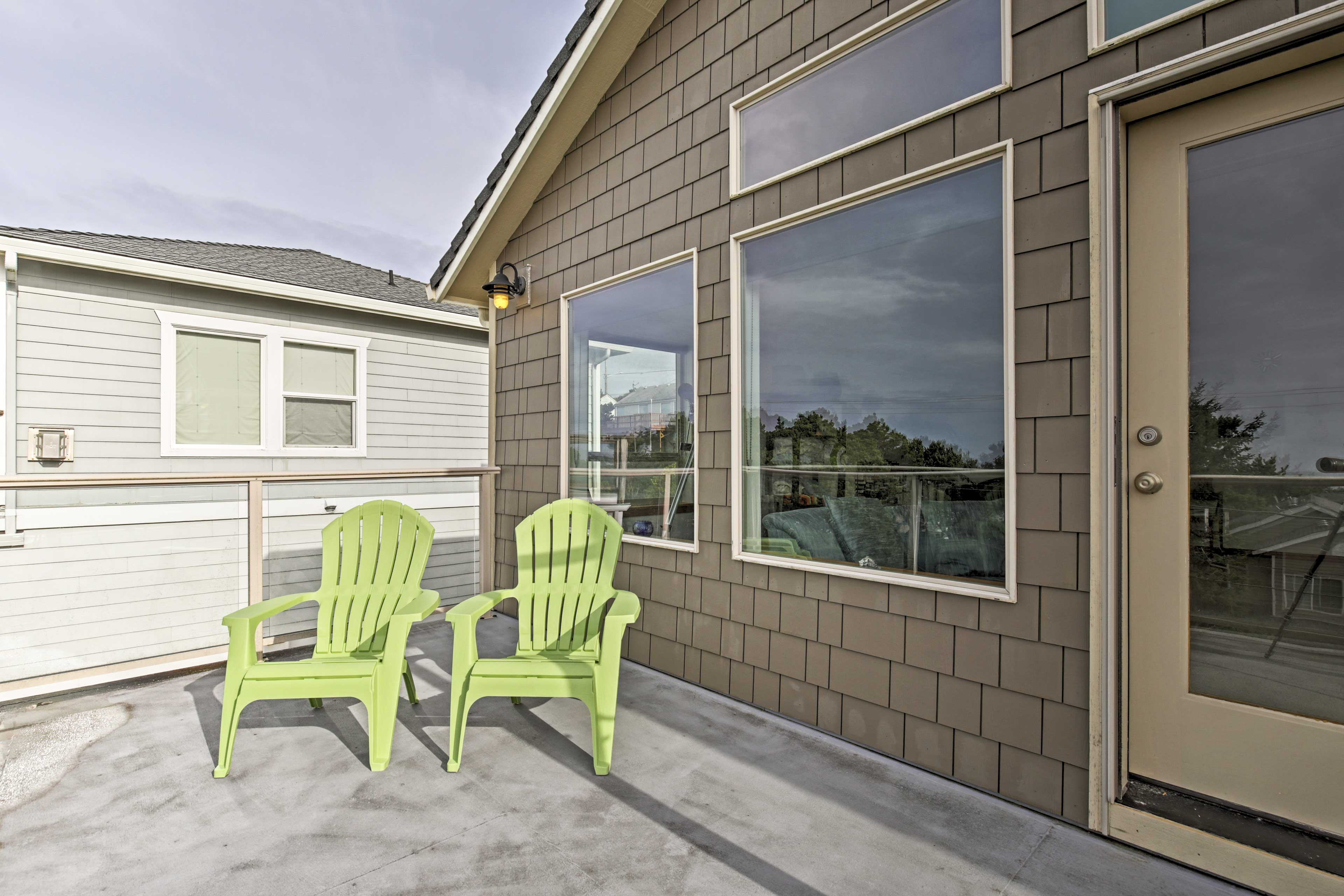 Soak up the sun's rays while you lounge in these Adirondack chairs.