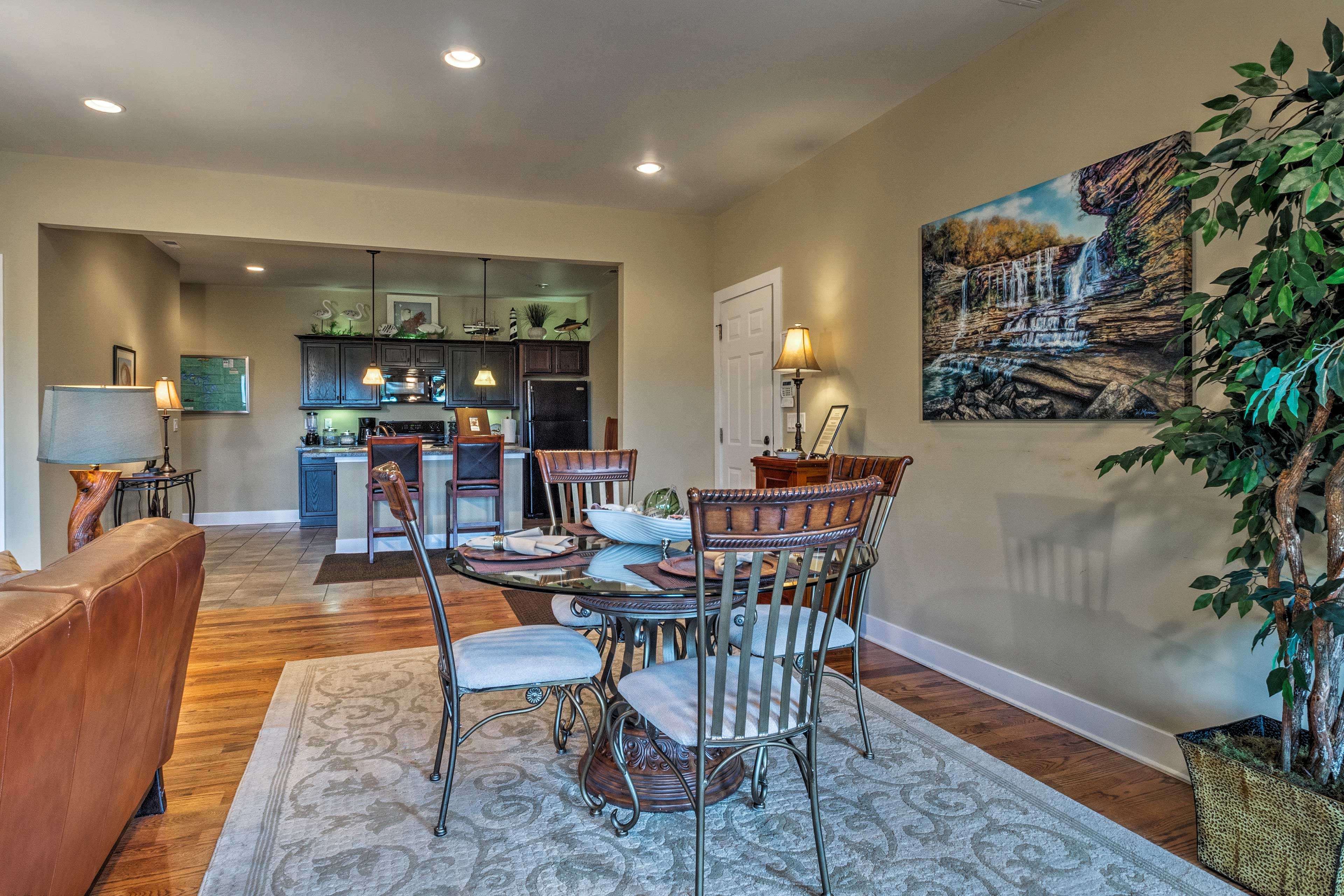 The open concept means you can enjoy the flat-screen TV from the table too!