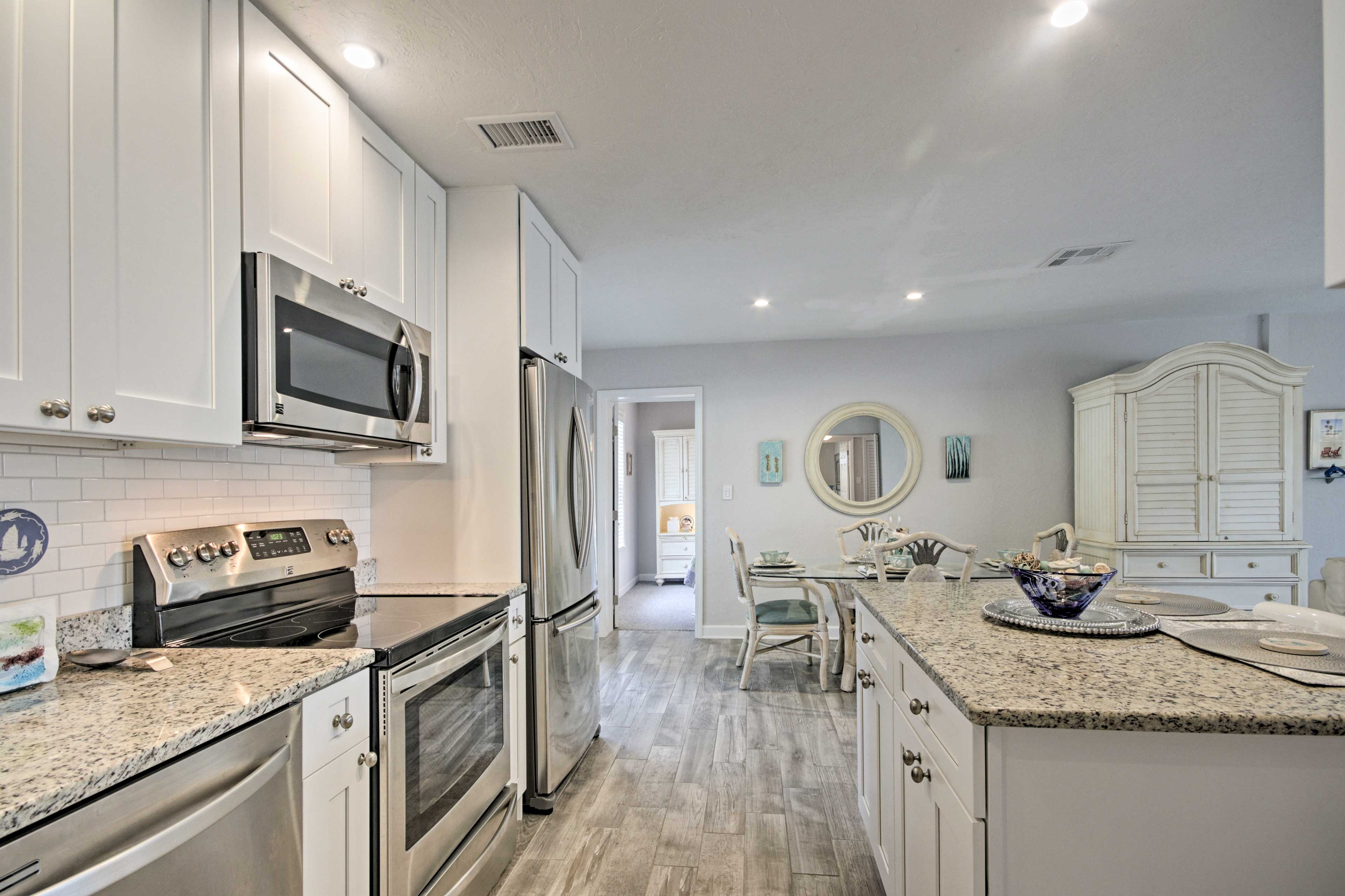 There is ample granite counter space to prep and serve on.