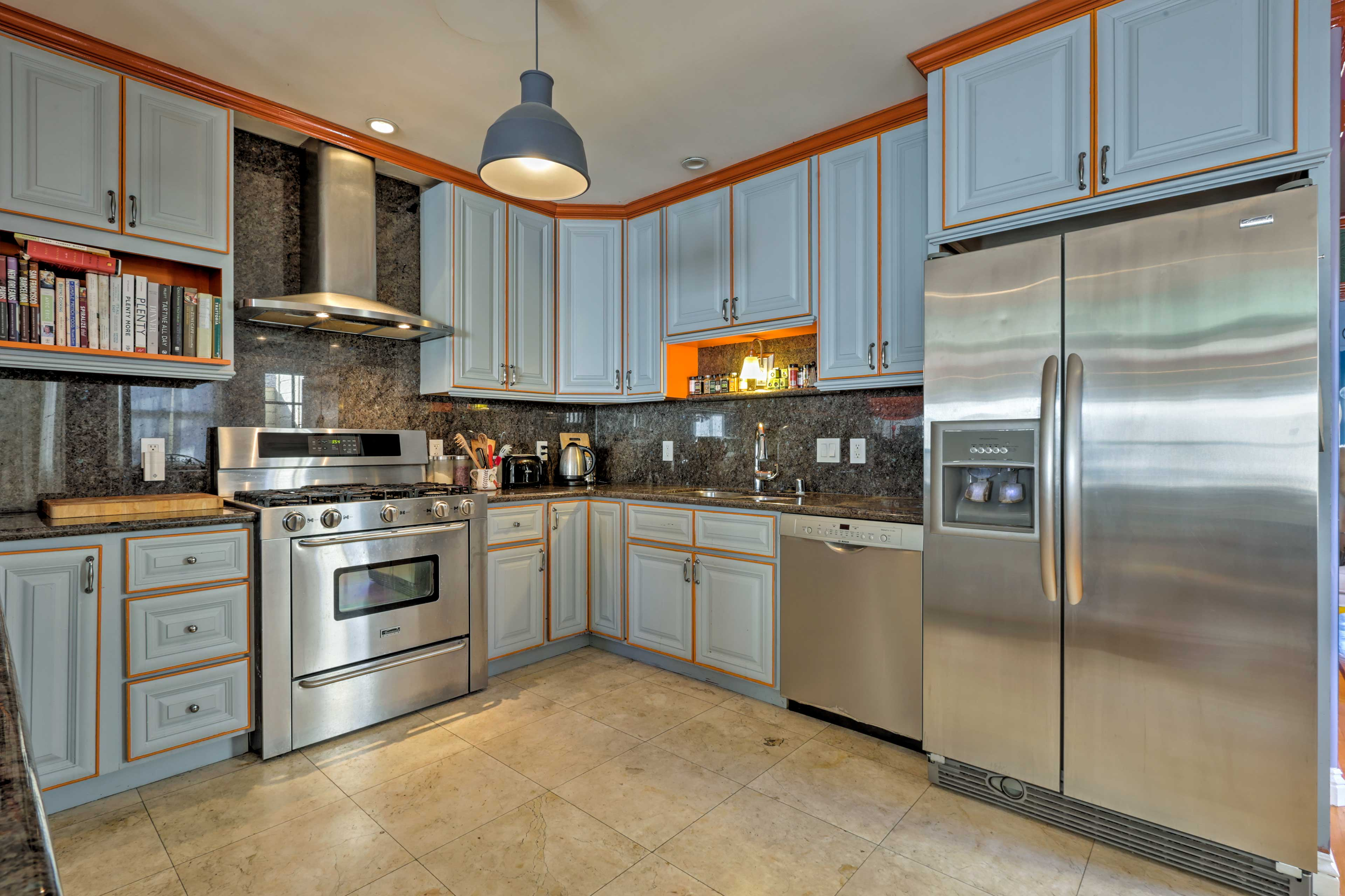 The kitchen is highlighted by stainless steel appliances and granite surfaces.