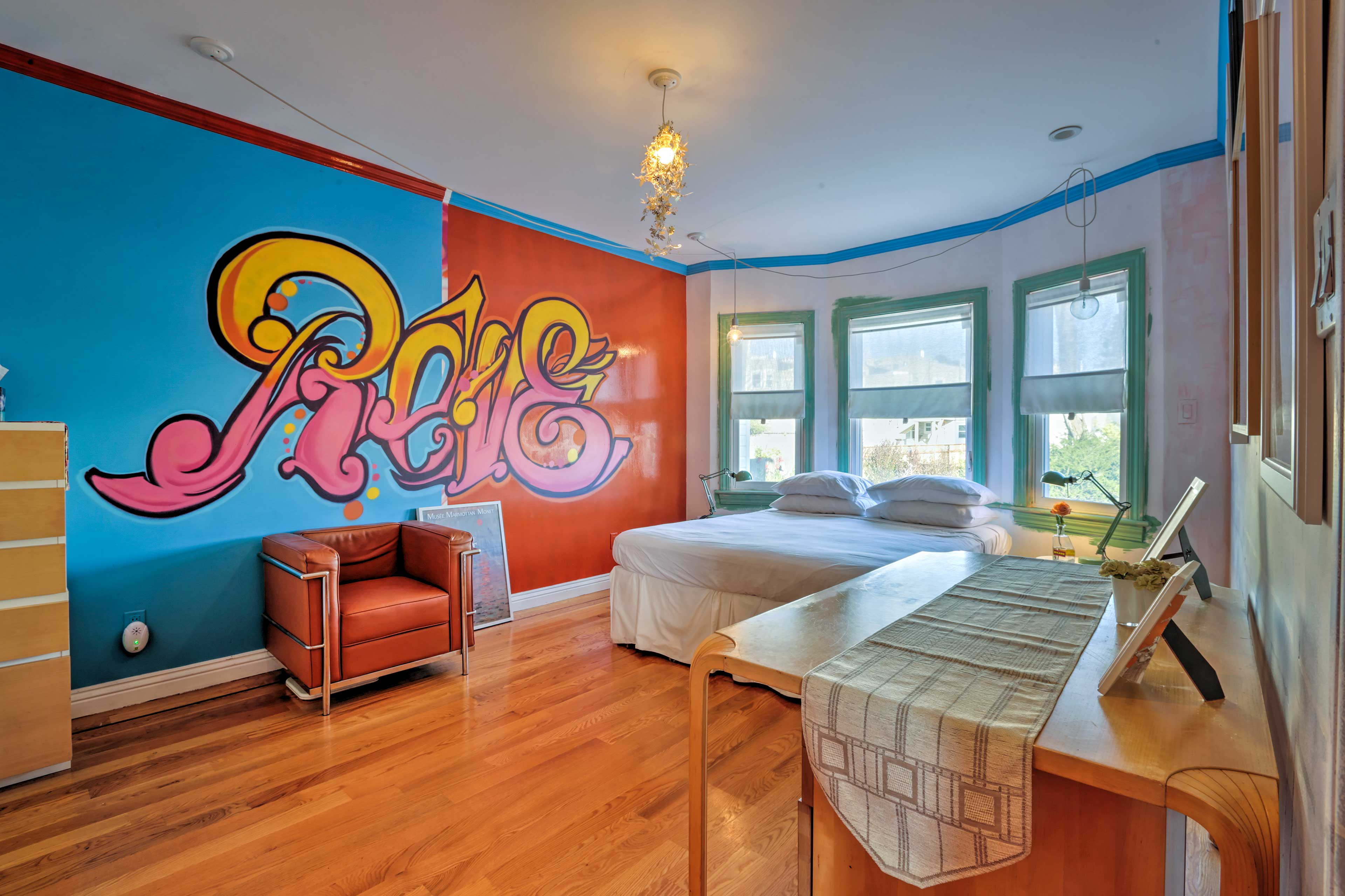Reve is painted across the wall of the first bedroom, the French word for dream.