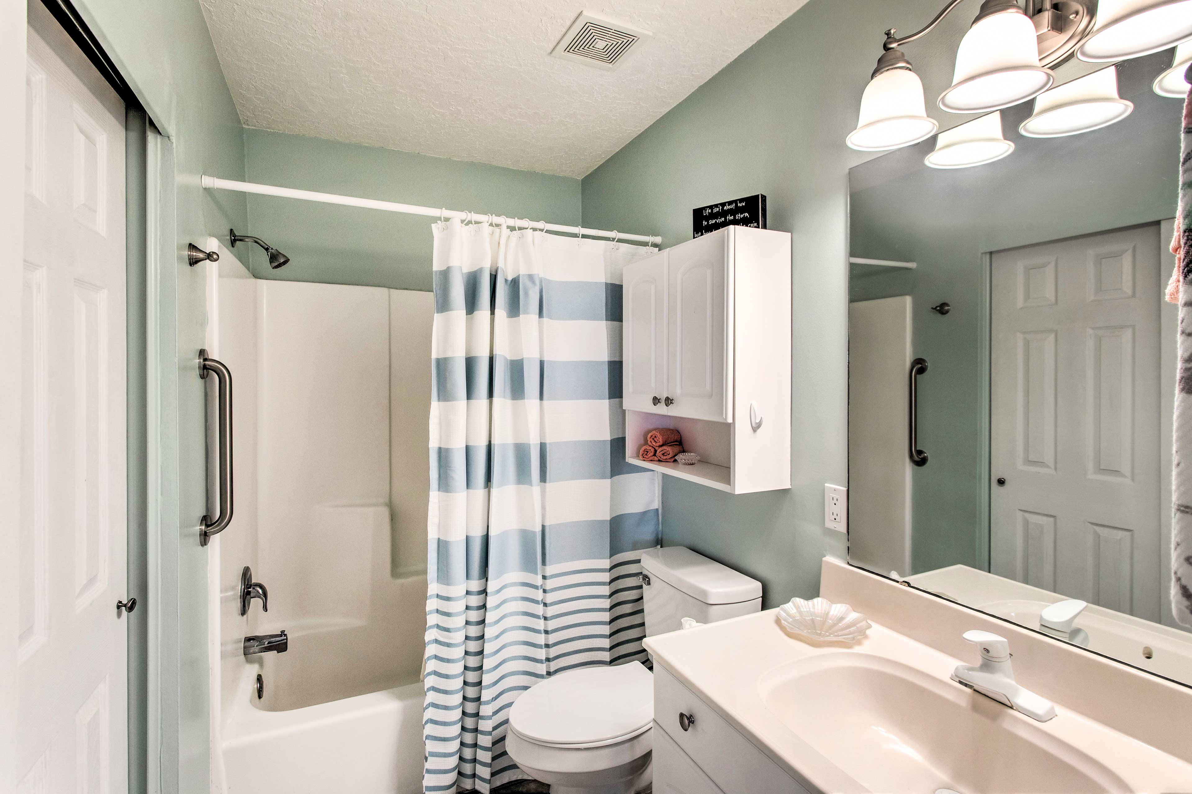 Rinse off the day in this convenient bathroom.
