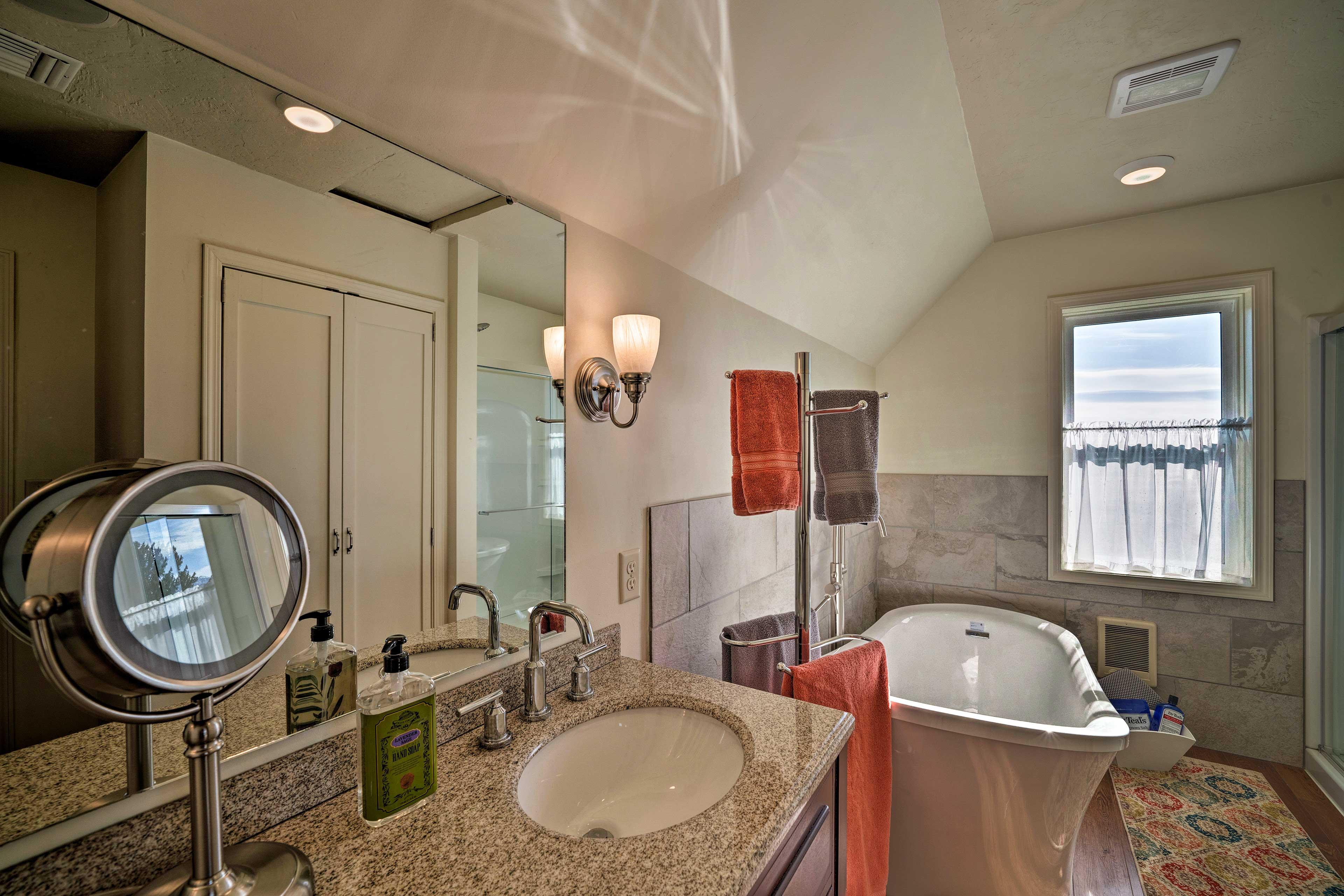 The en-suite bathroom has a large soaking tub.