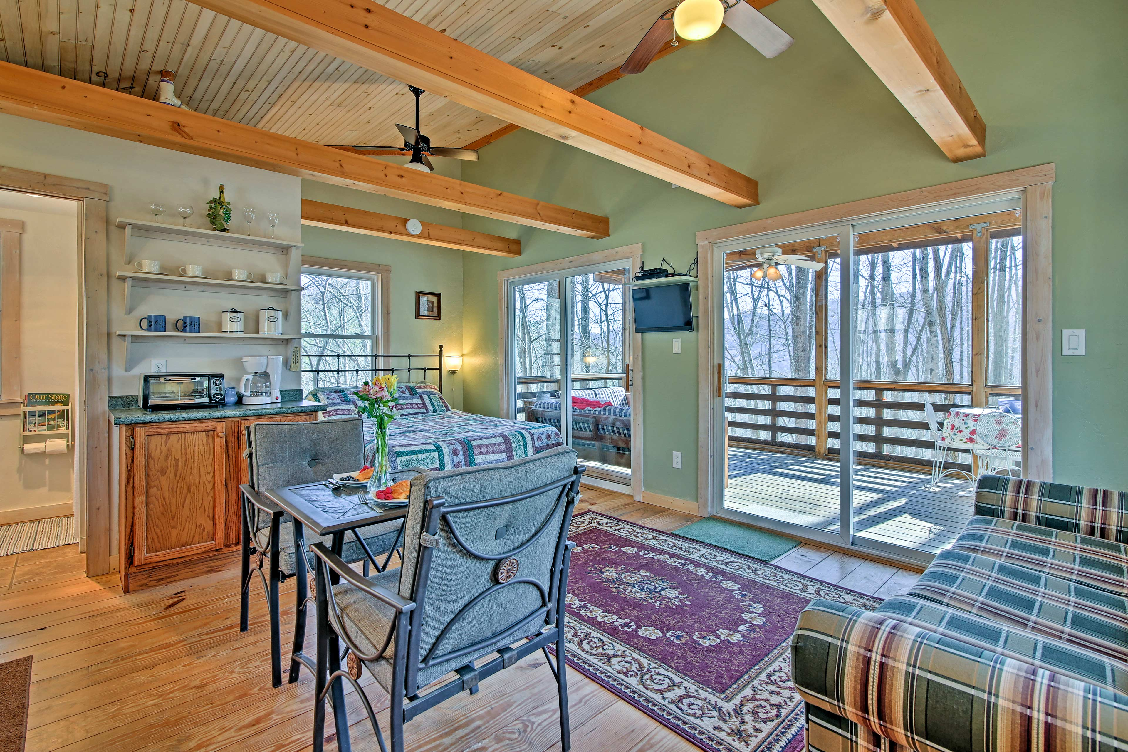 The cabin features exposed-beam ceilings.