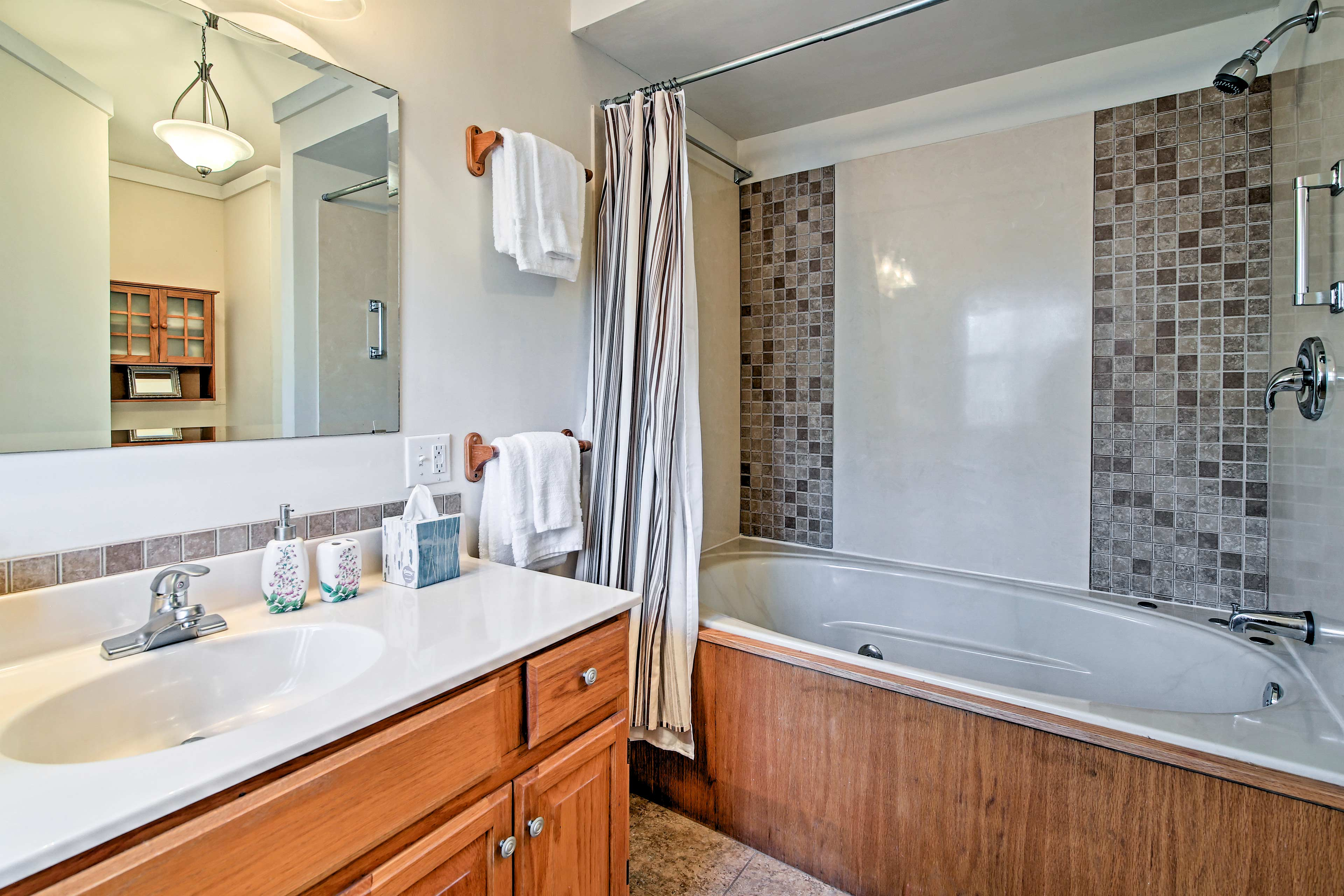 Take a hot shower in the full bathroom after a fun-filled day hiking.