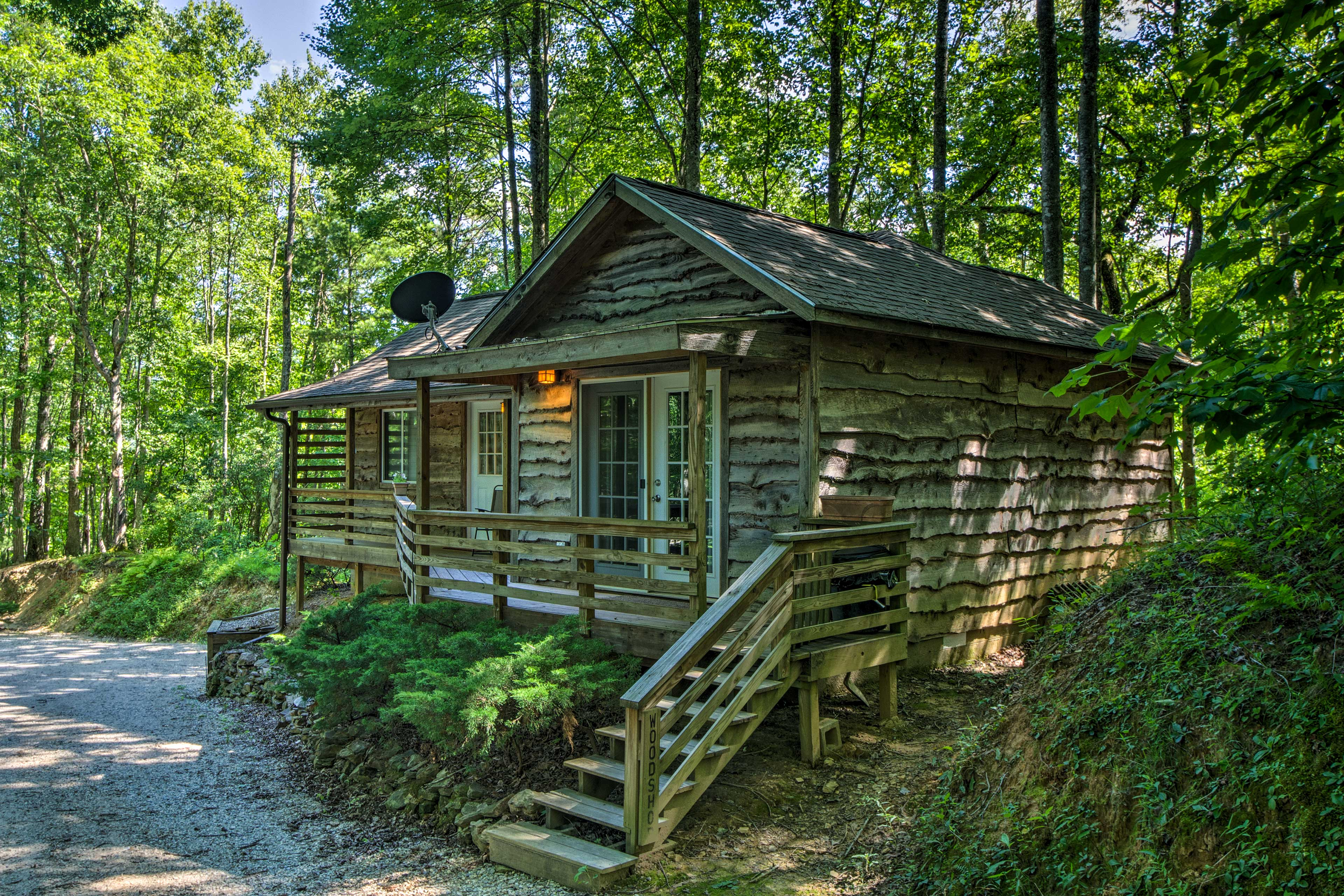 Stay at 'The Woodshop,' a 1-bed, 1.5-bath vacation rental cabin.