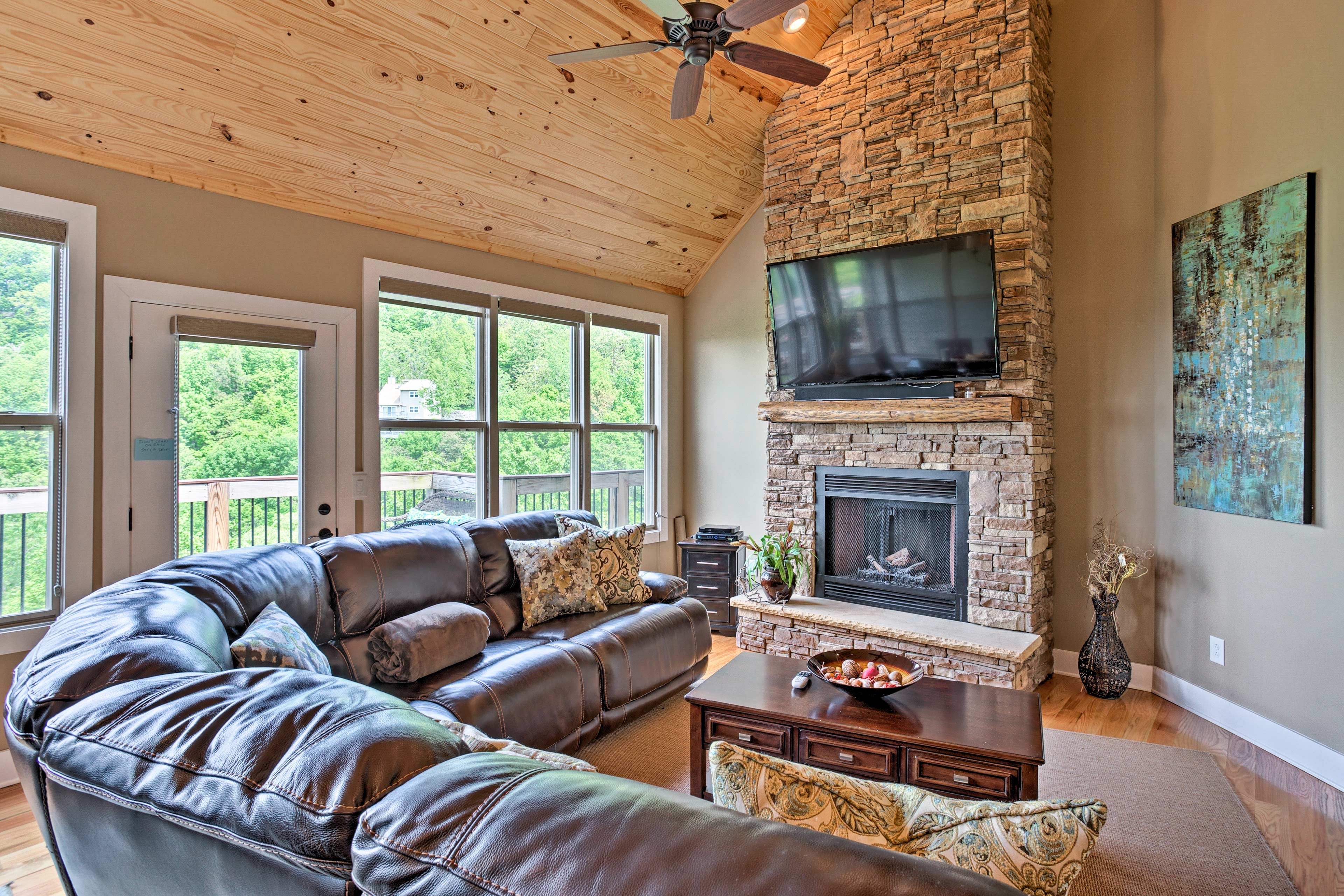 A floor-to-ceiling stone fireplace highlights the living room.