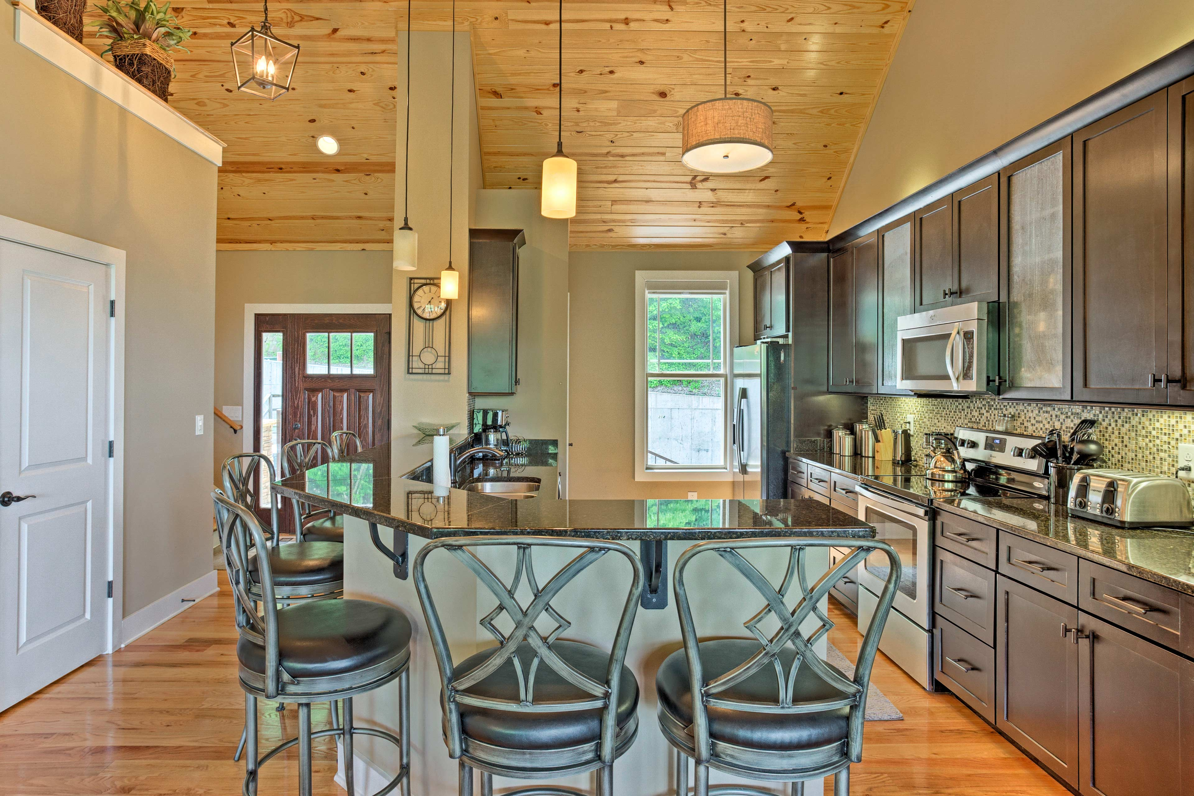 Hardwood floors and vaulted ceilings flow throughout.