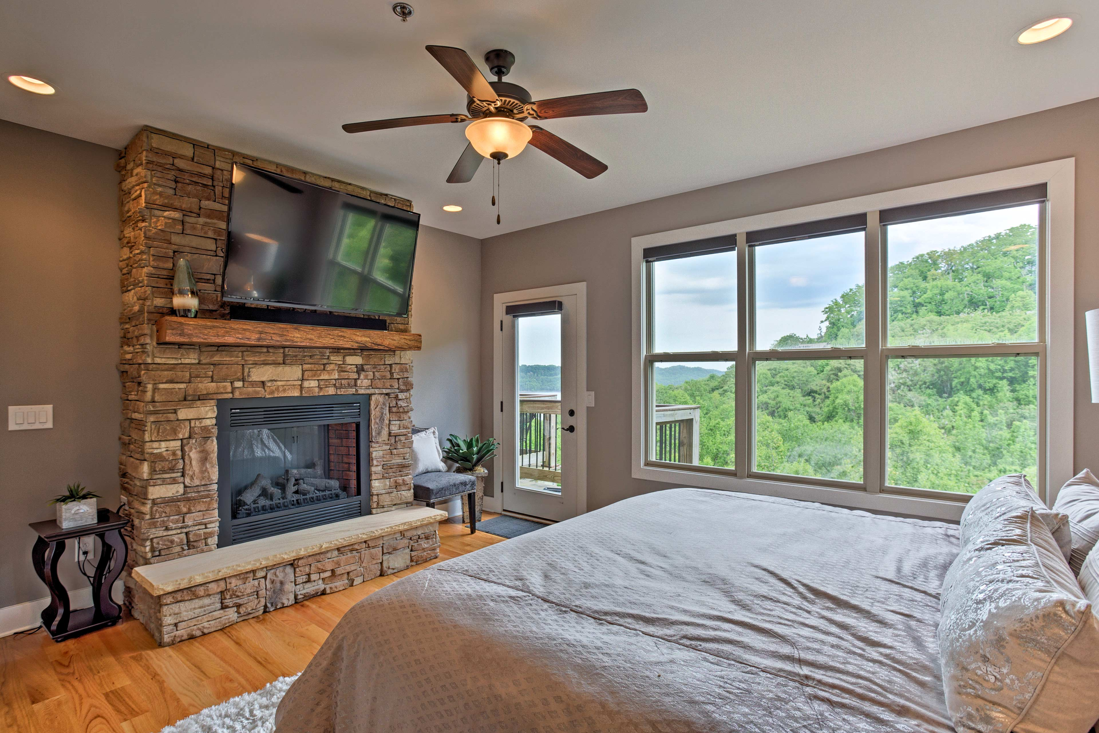 The master suite boasts a fireplace, flat-screen TV, and deck access!