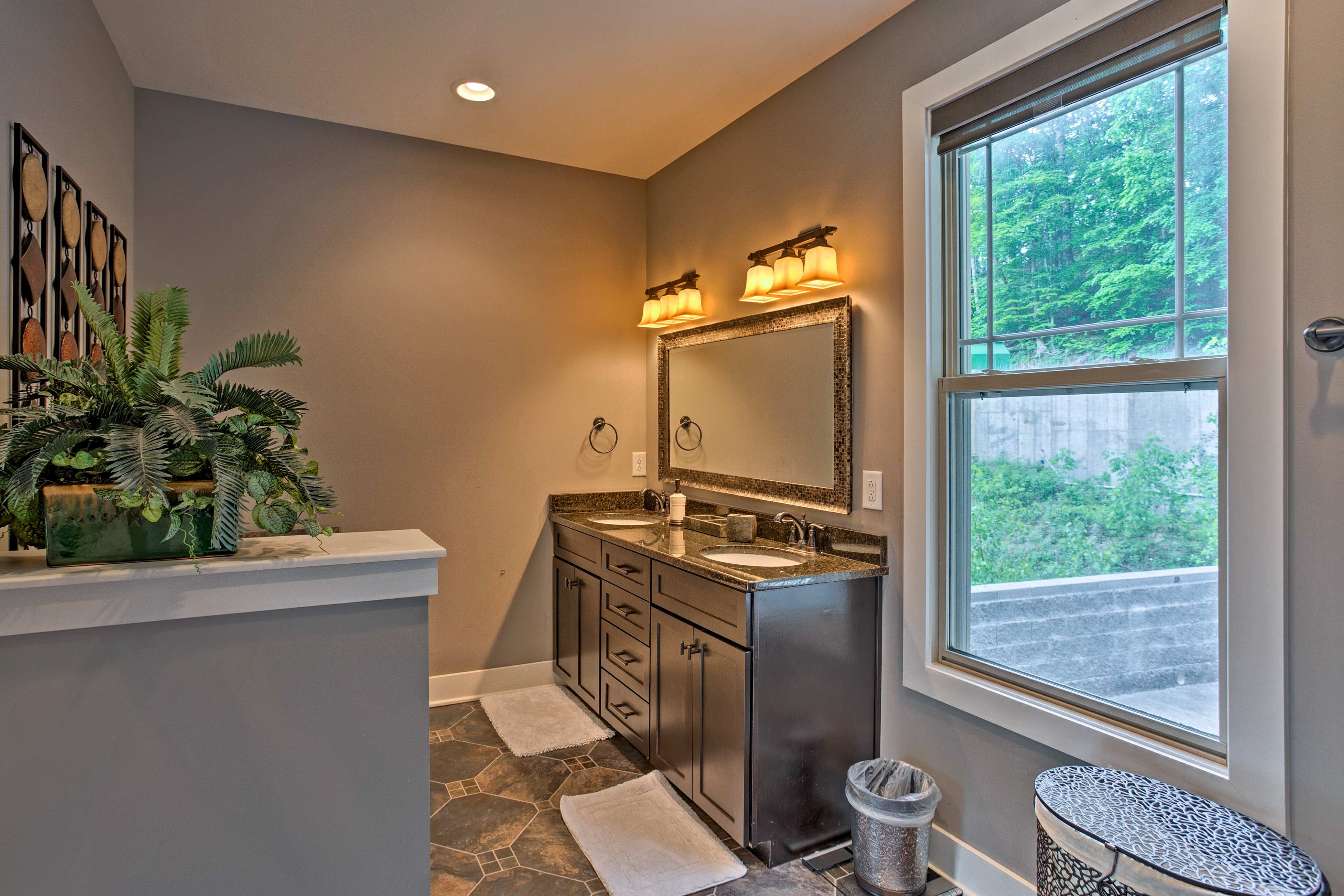 Conveniently utilize the his-and-hers sinks while getting ready!