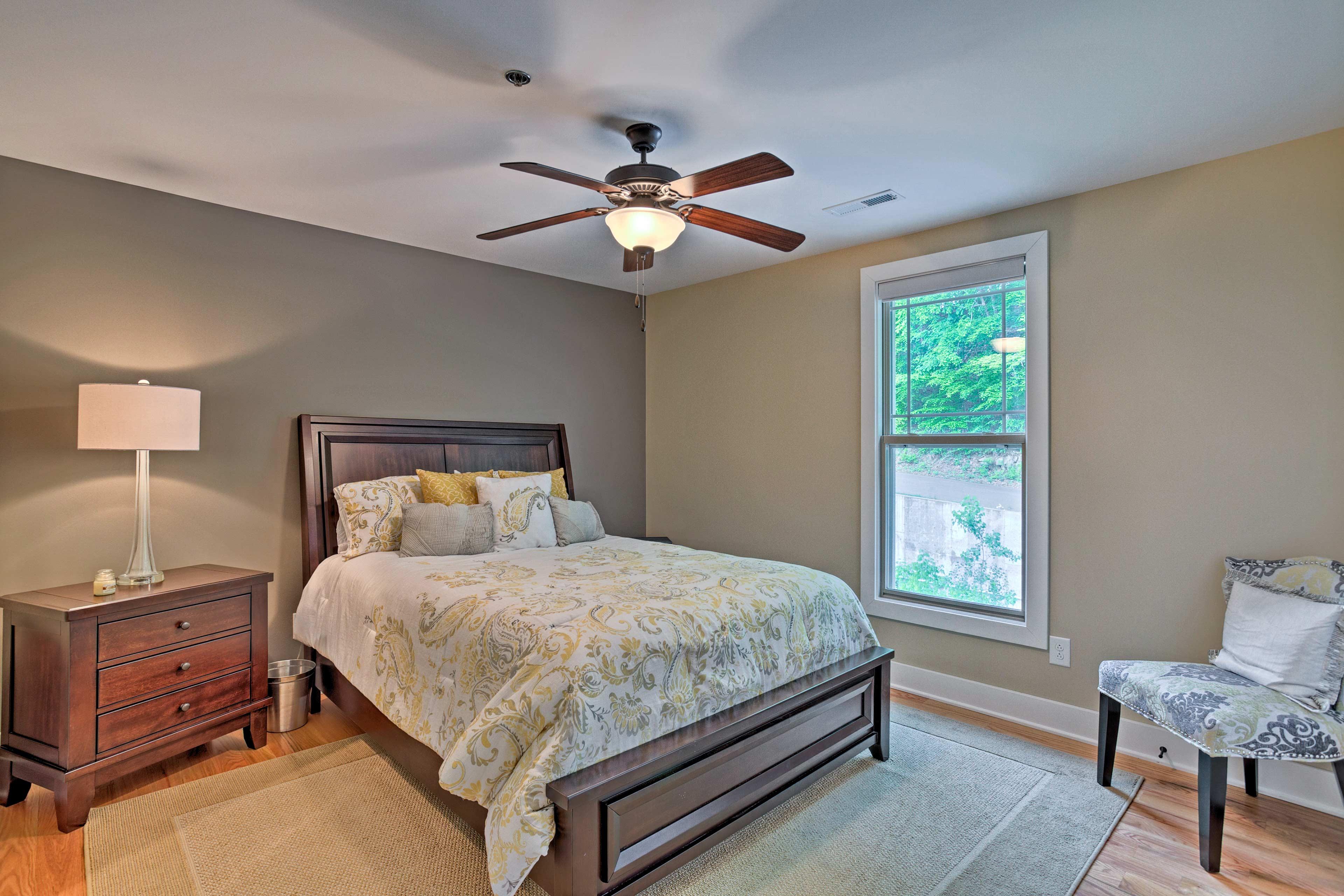 Each spacious bedroom includes wood furnishings.