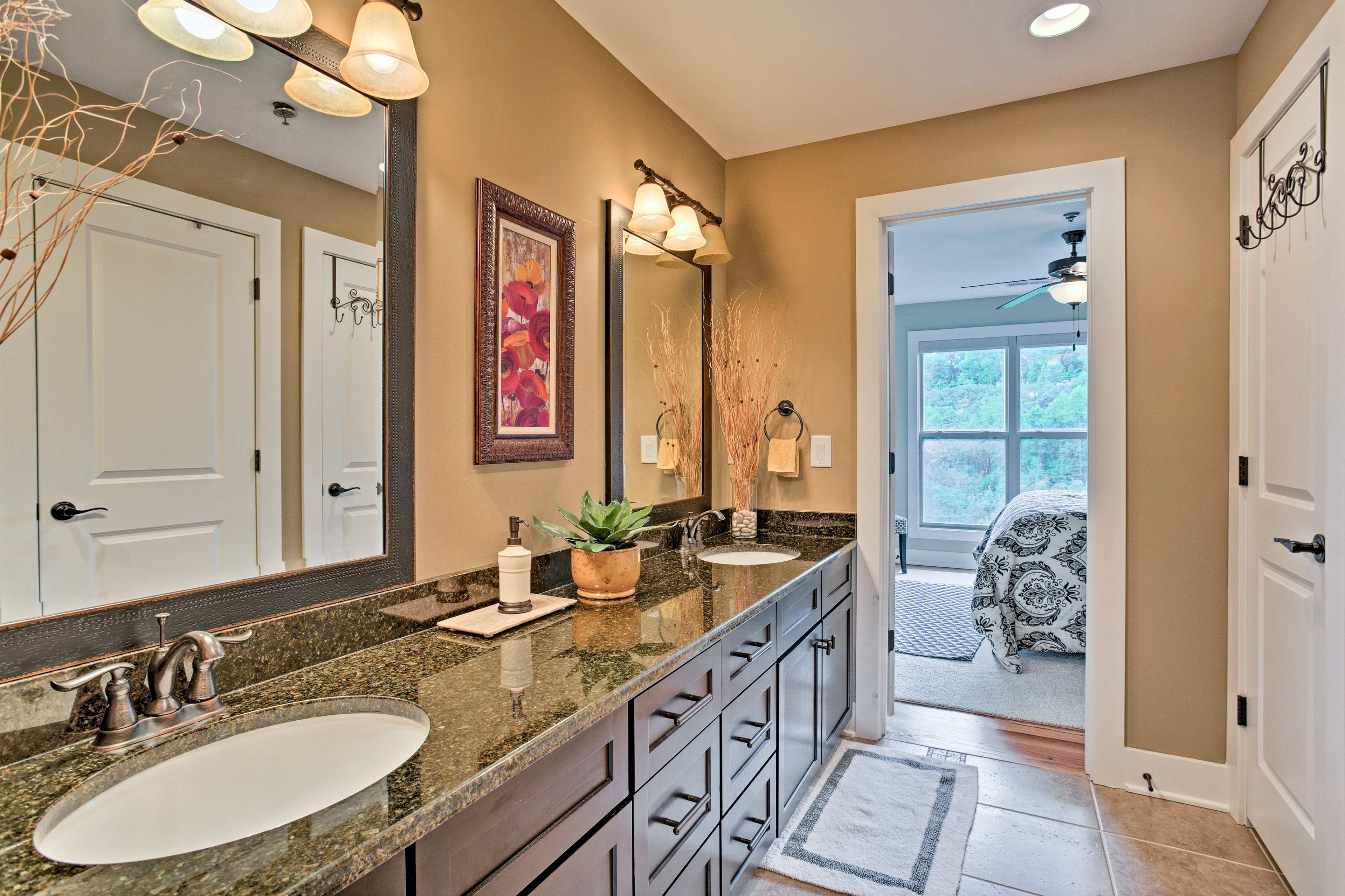 The Jack-and-Jill bathroom also includes a double vanity.