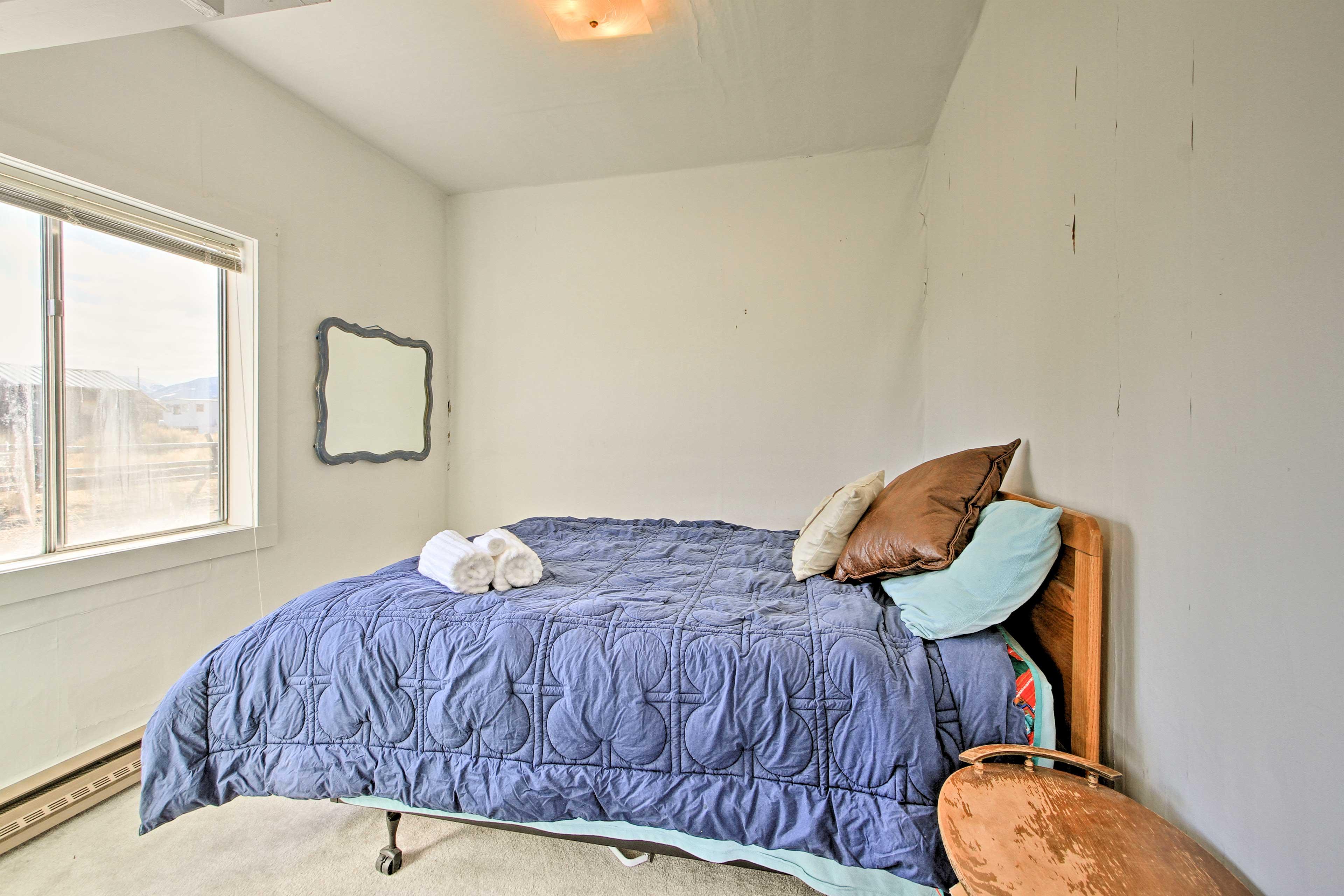 Peaceful slumbers await in the master bedroom.