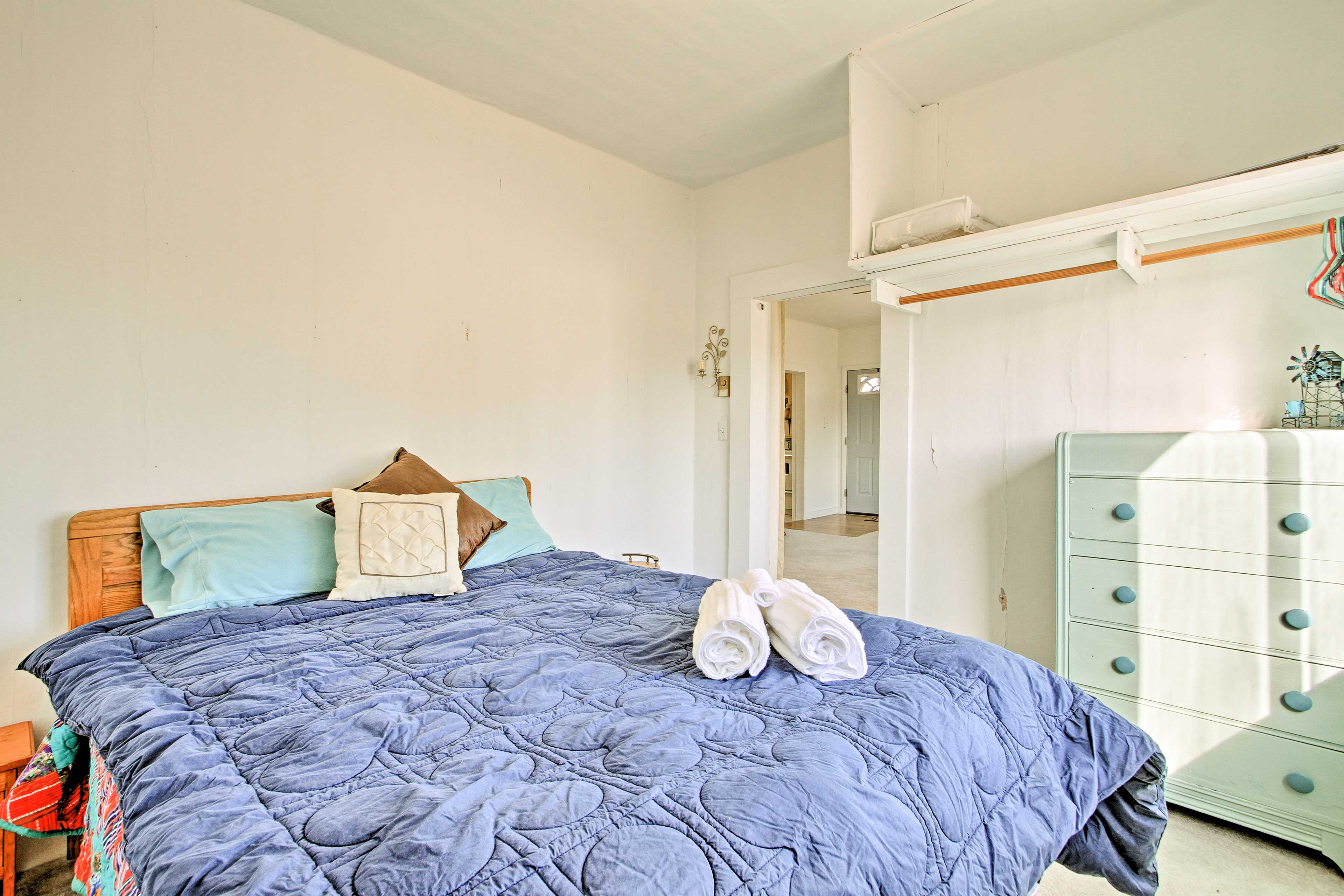 The master bedroom features a comfortable queen bed.