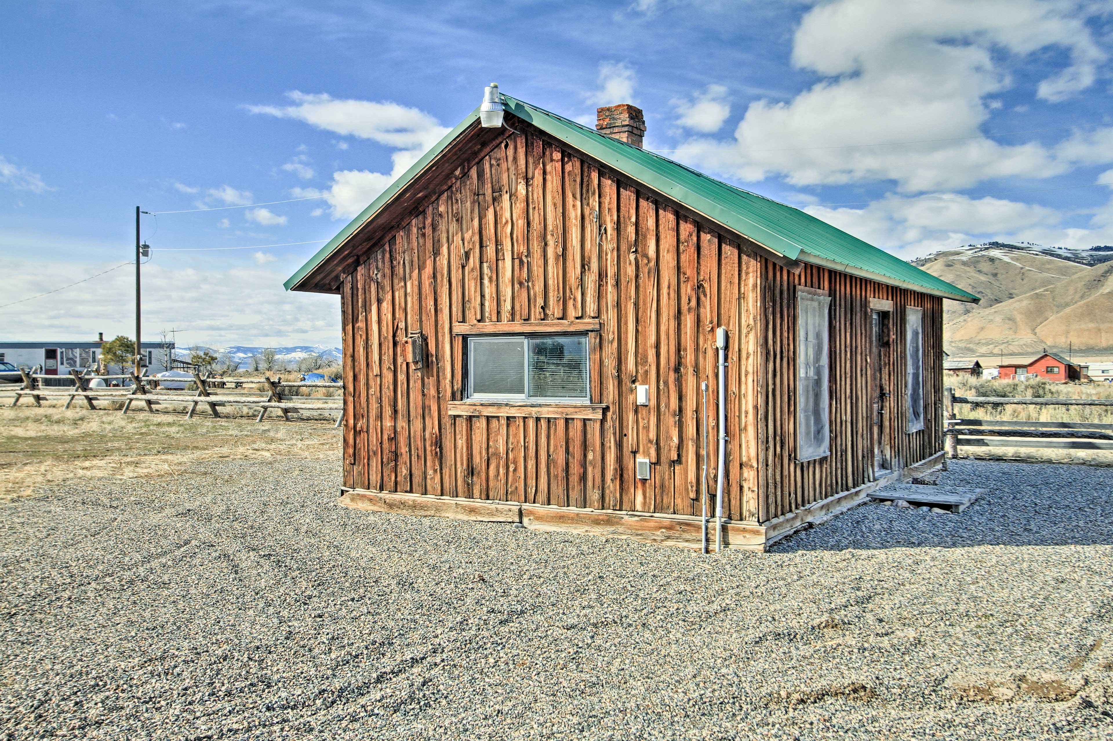 Utilize the original, rustic cabin for events and entertaining.