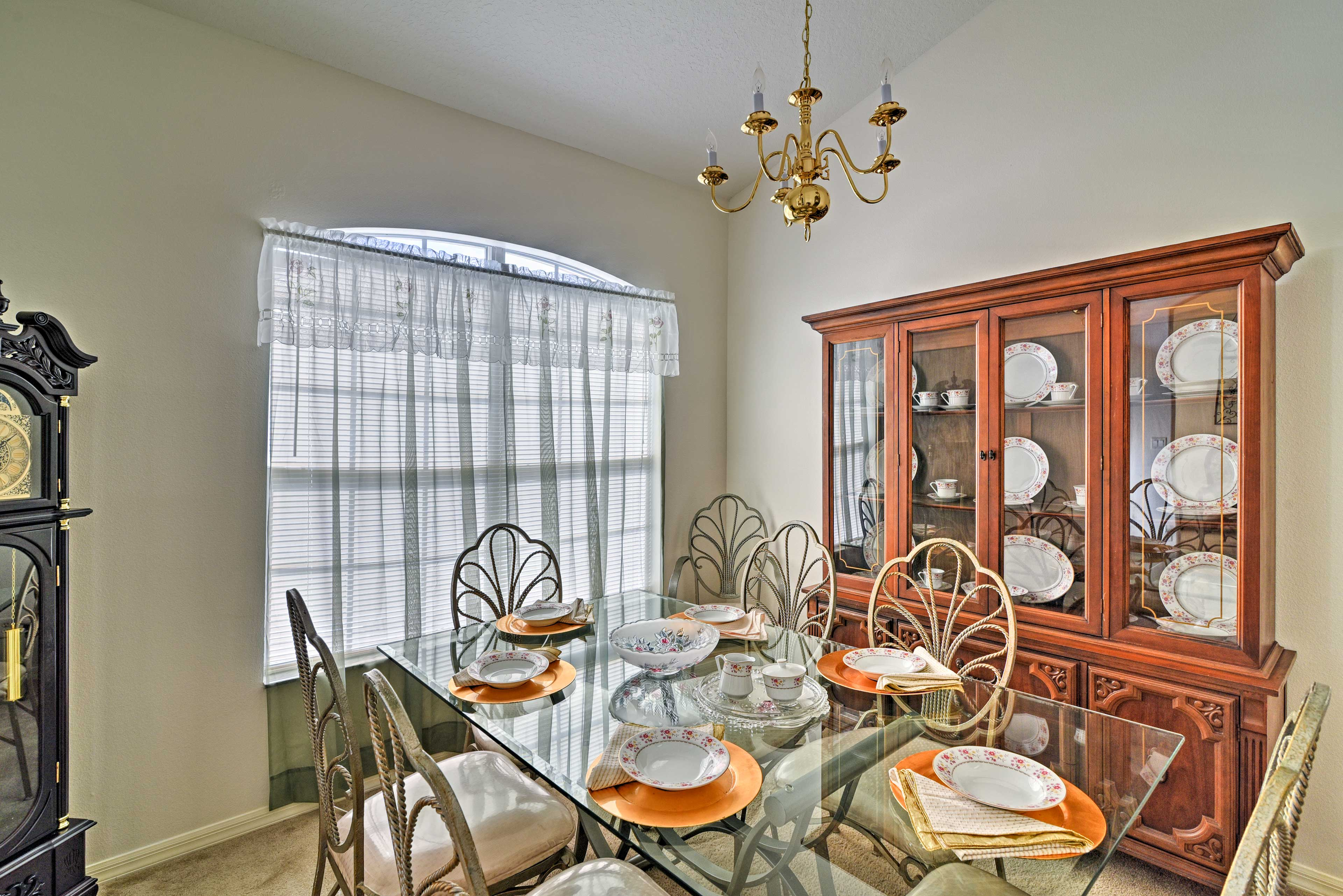 A glass-topped table completes this formal dining room.