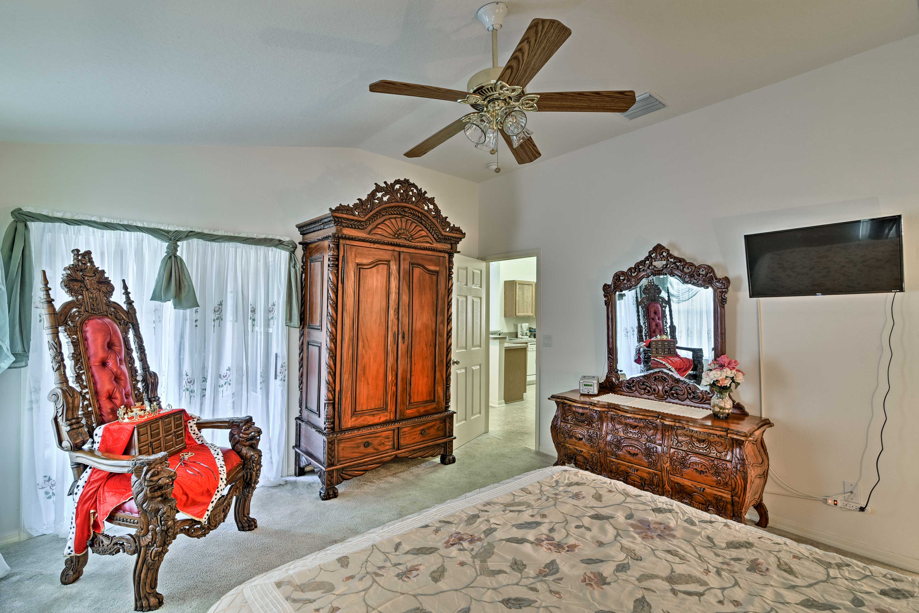 """The Royal Suite features a large, red """"Throne"""" chair for family photos."""