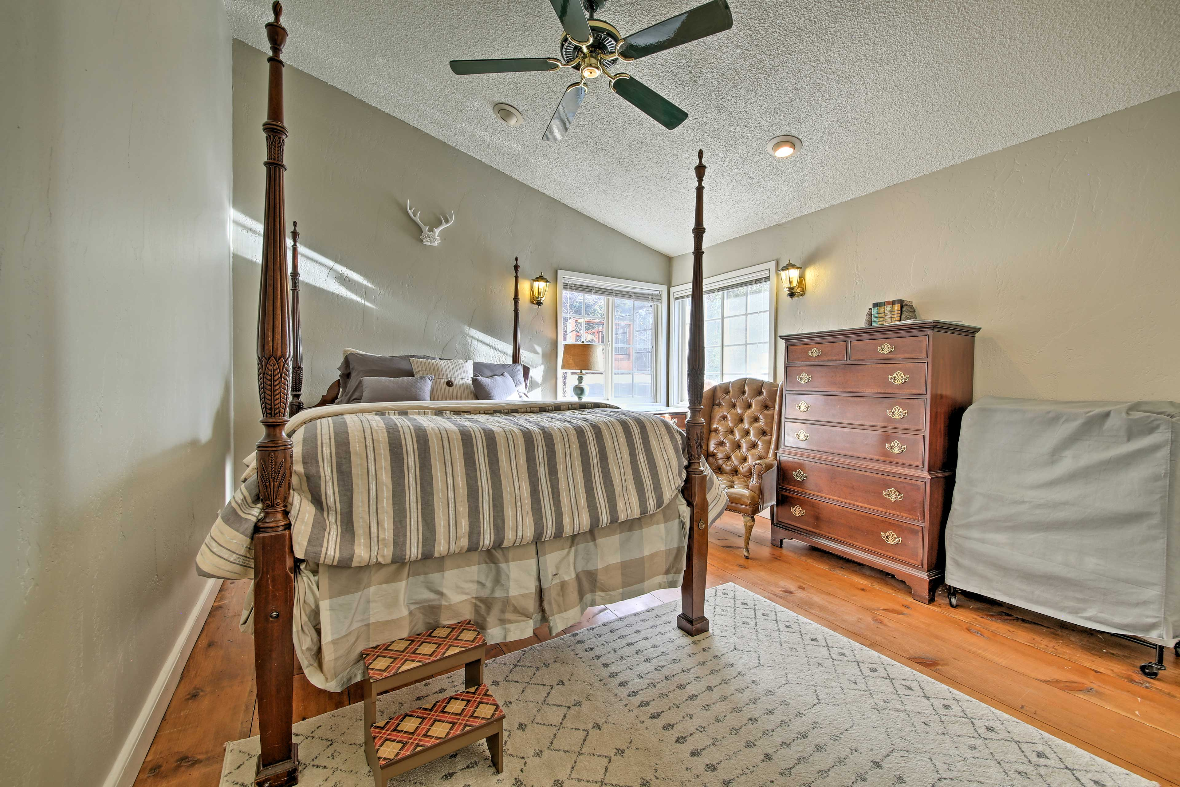 The guest suite provides a plush queen bed.