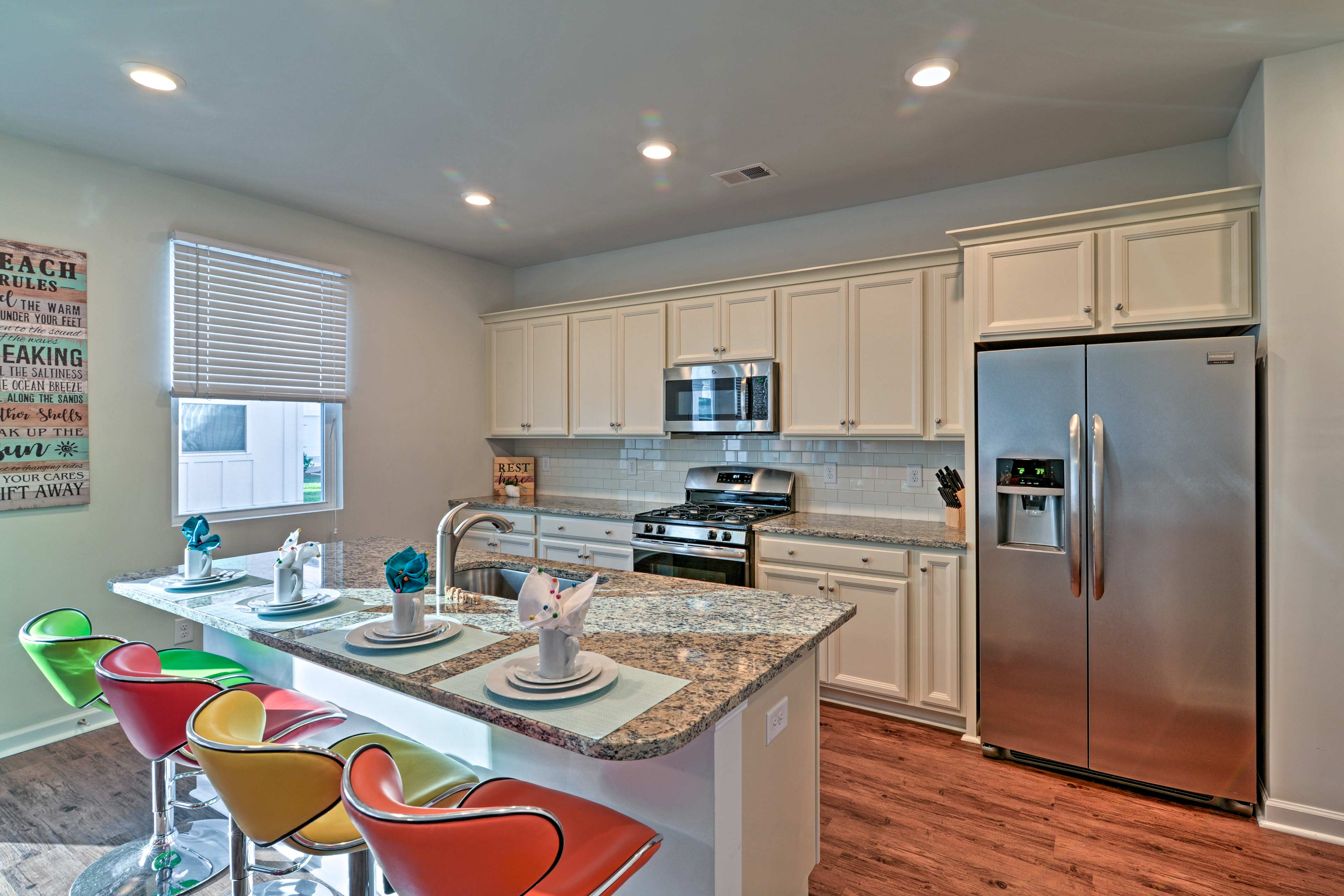 The fully equipped kitchen features stainless steel appliances.
