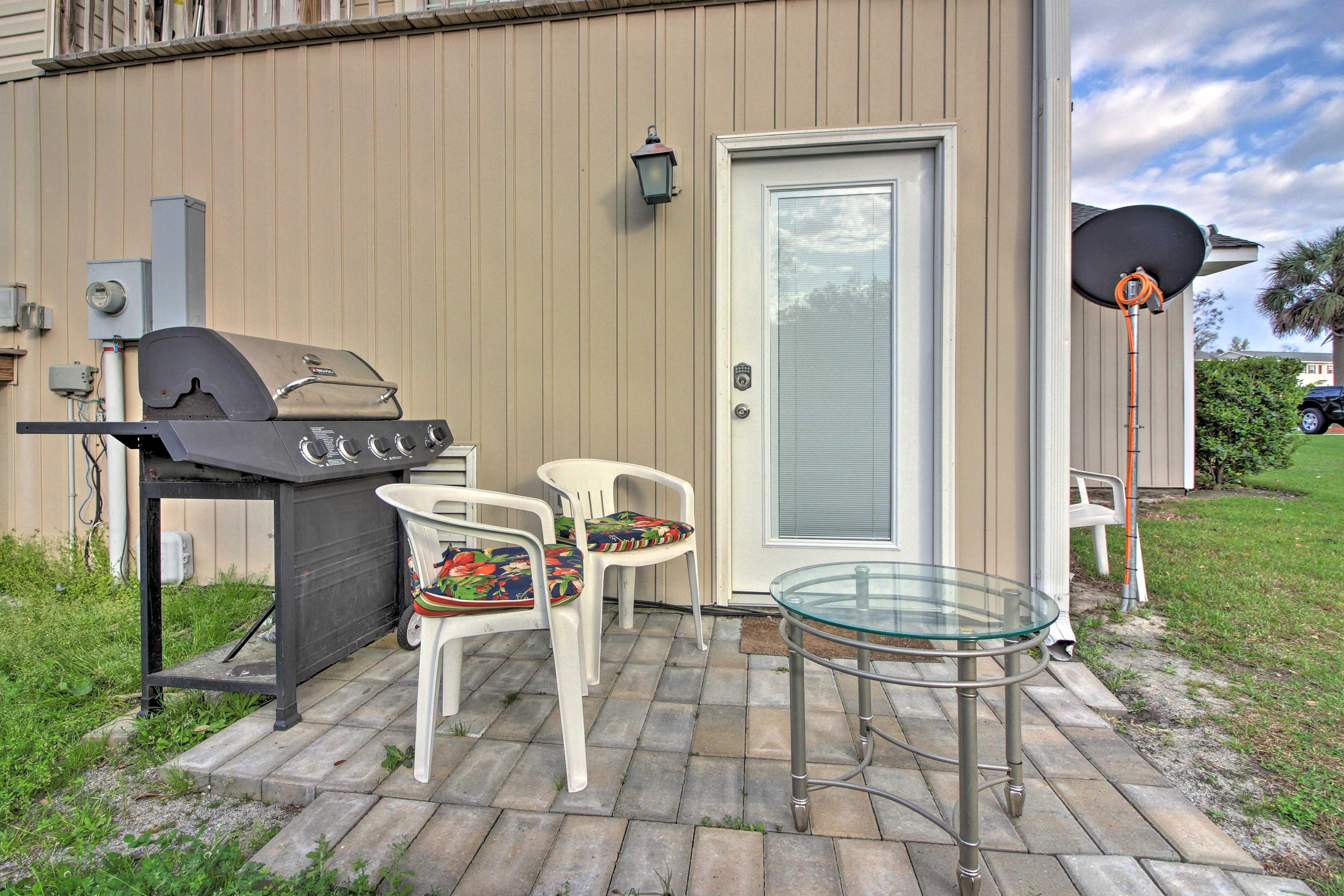Enjoy leisurely afternoons on your private patio featuring a gas grill.