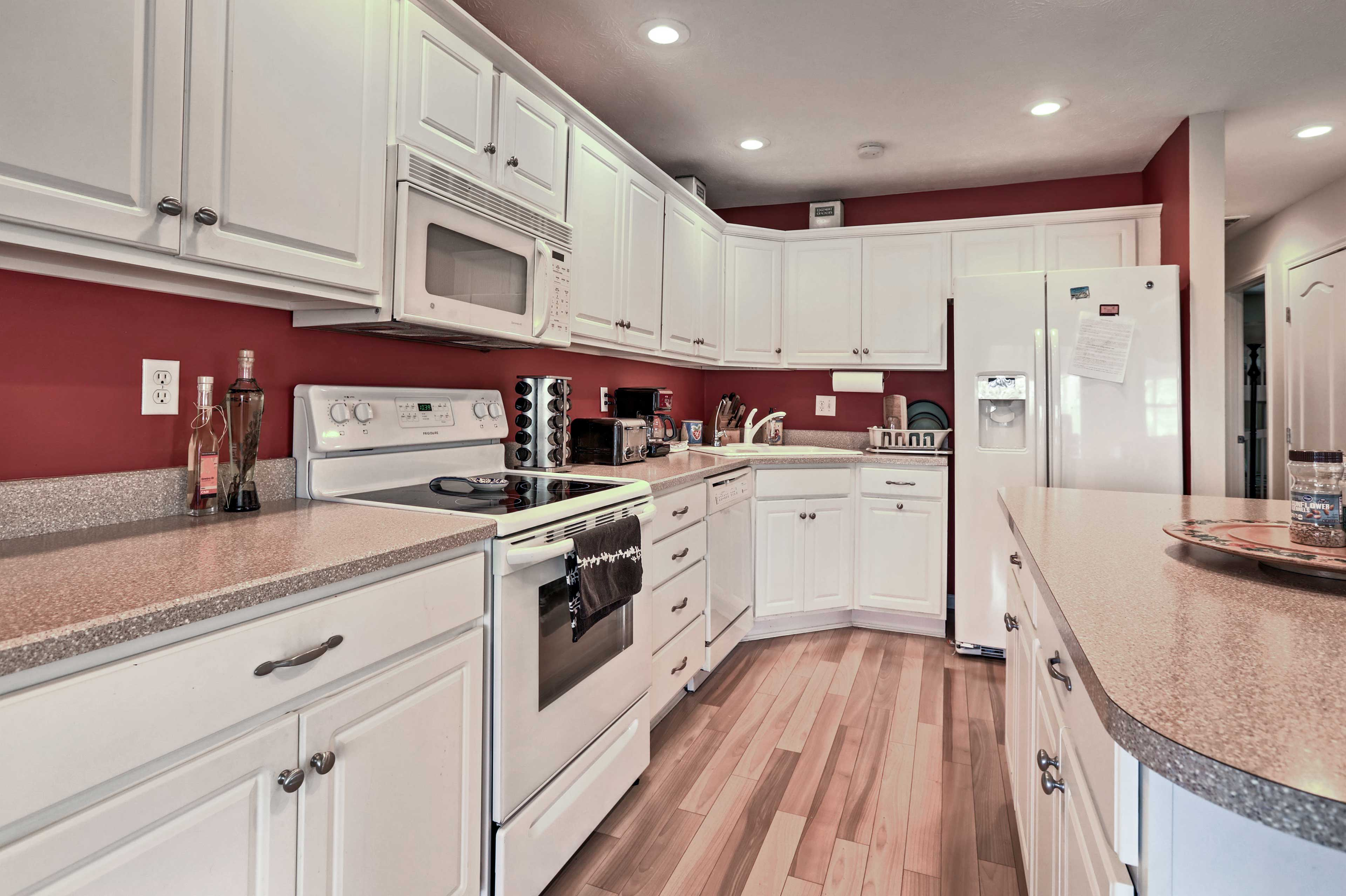 White cabinets and appliances give this bright kitchen a clean, fresh vibe.